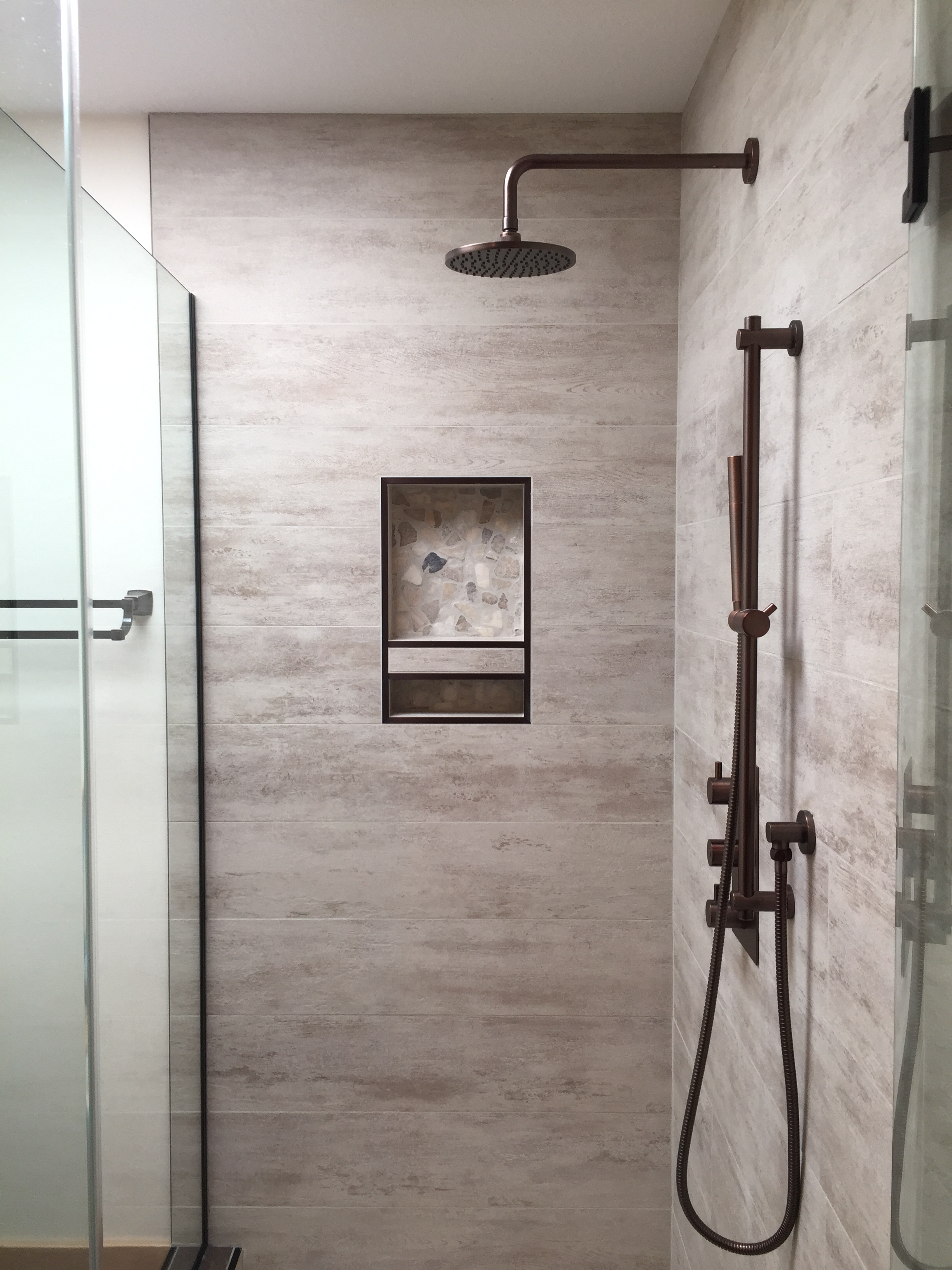 Custom shower, antique bronze rain head shower and hand shower combination.