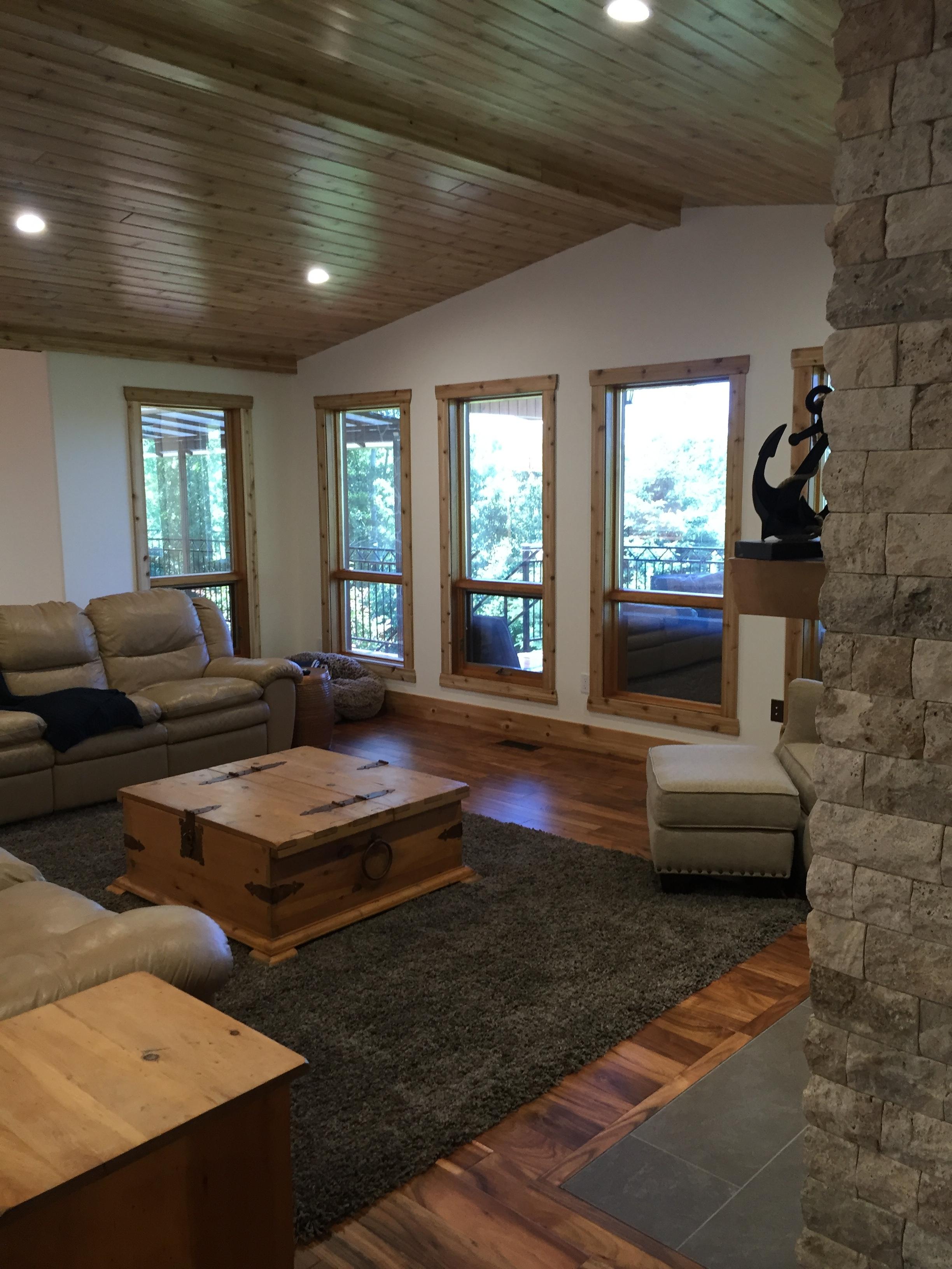 Rustic stone fireplace, cedar ceilings and window trim.