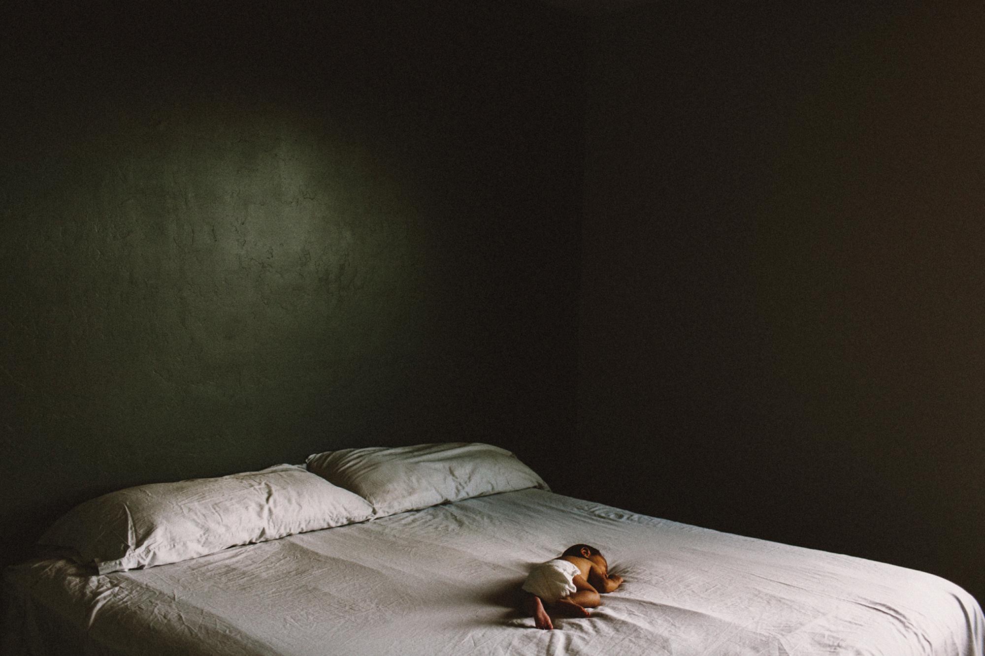 Newborn on bed