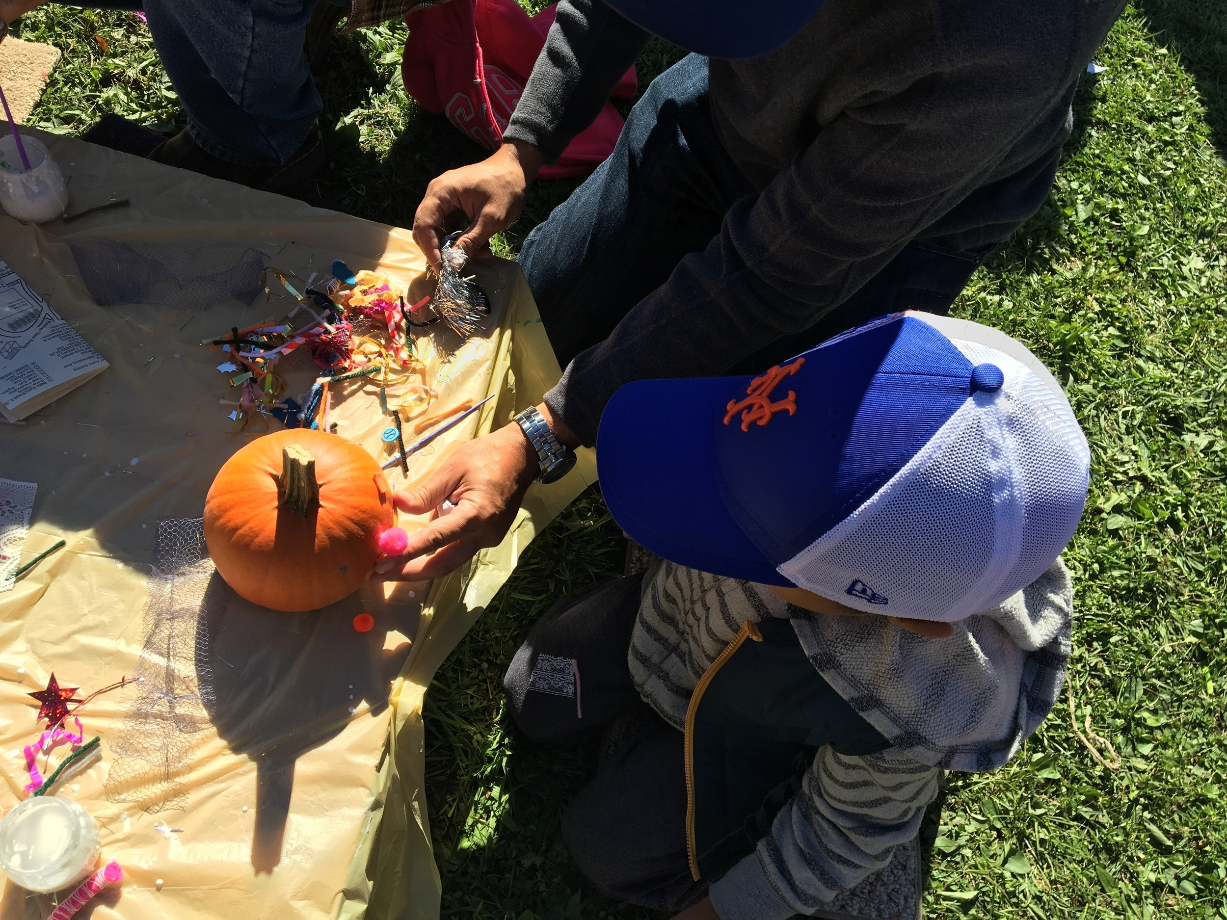My husband and son decorating a pumpkin.