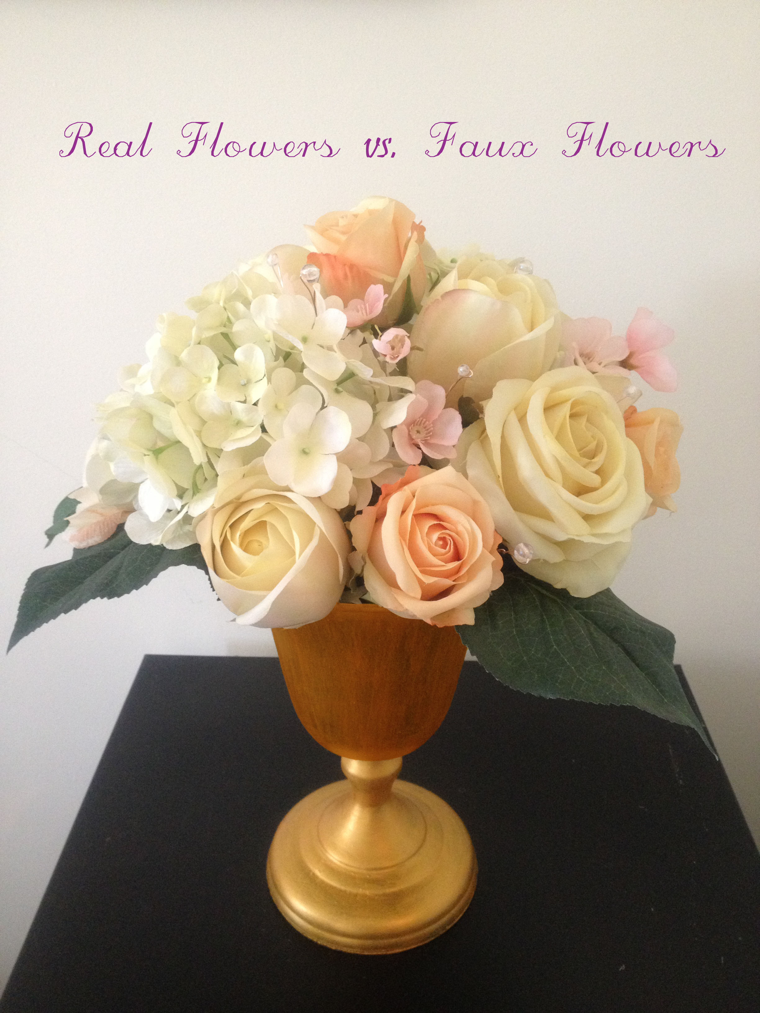 This arrangement we created for an Event planner. This is faux flower piece.