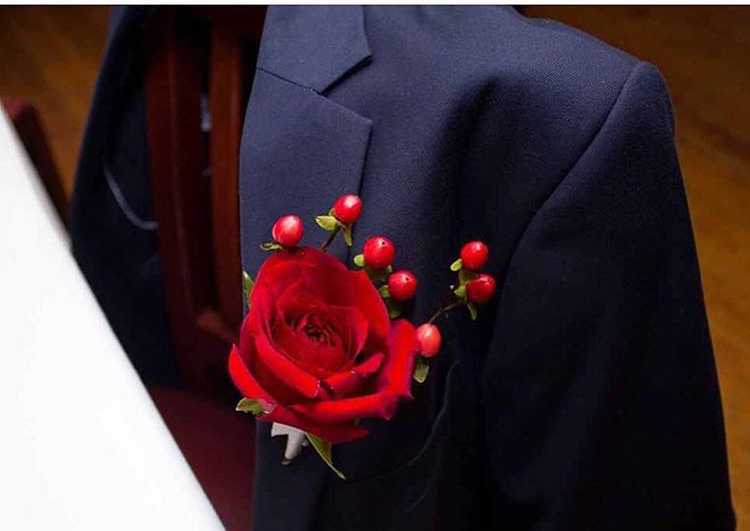 Groomsmen boutonniere photo provided by DPSnapsphotography