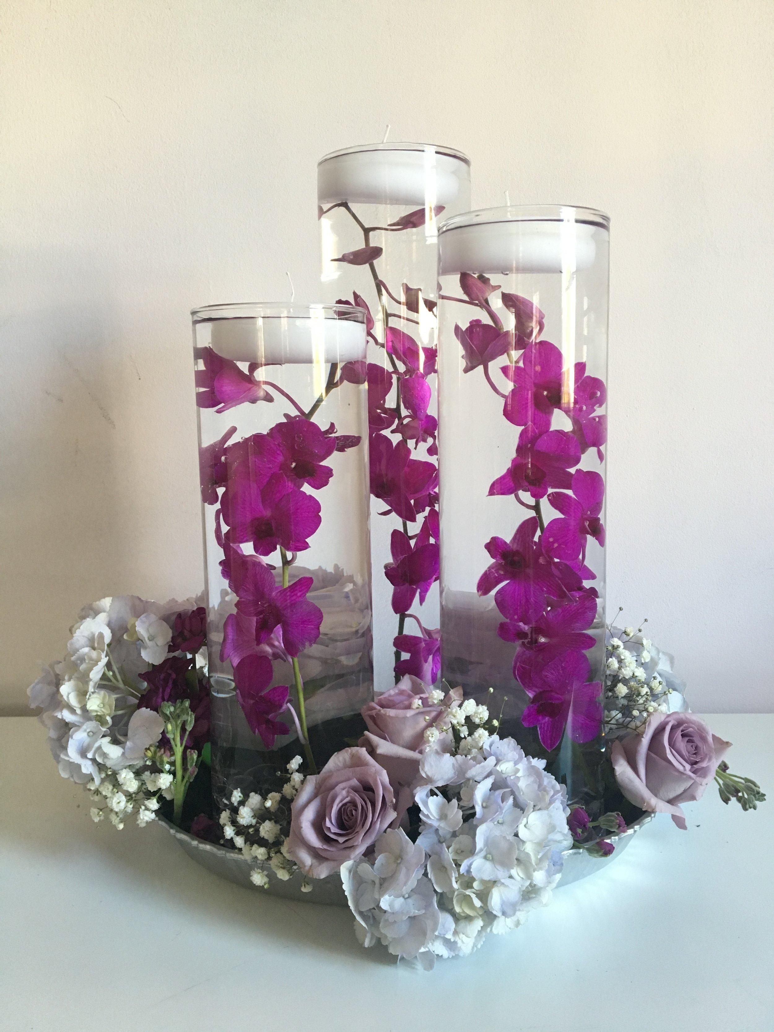 Evelisa Floral & Design: Floating candle arrangement