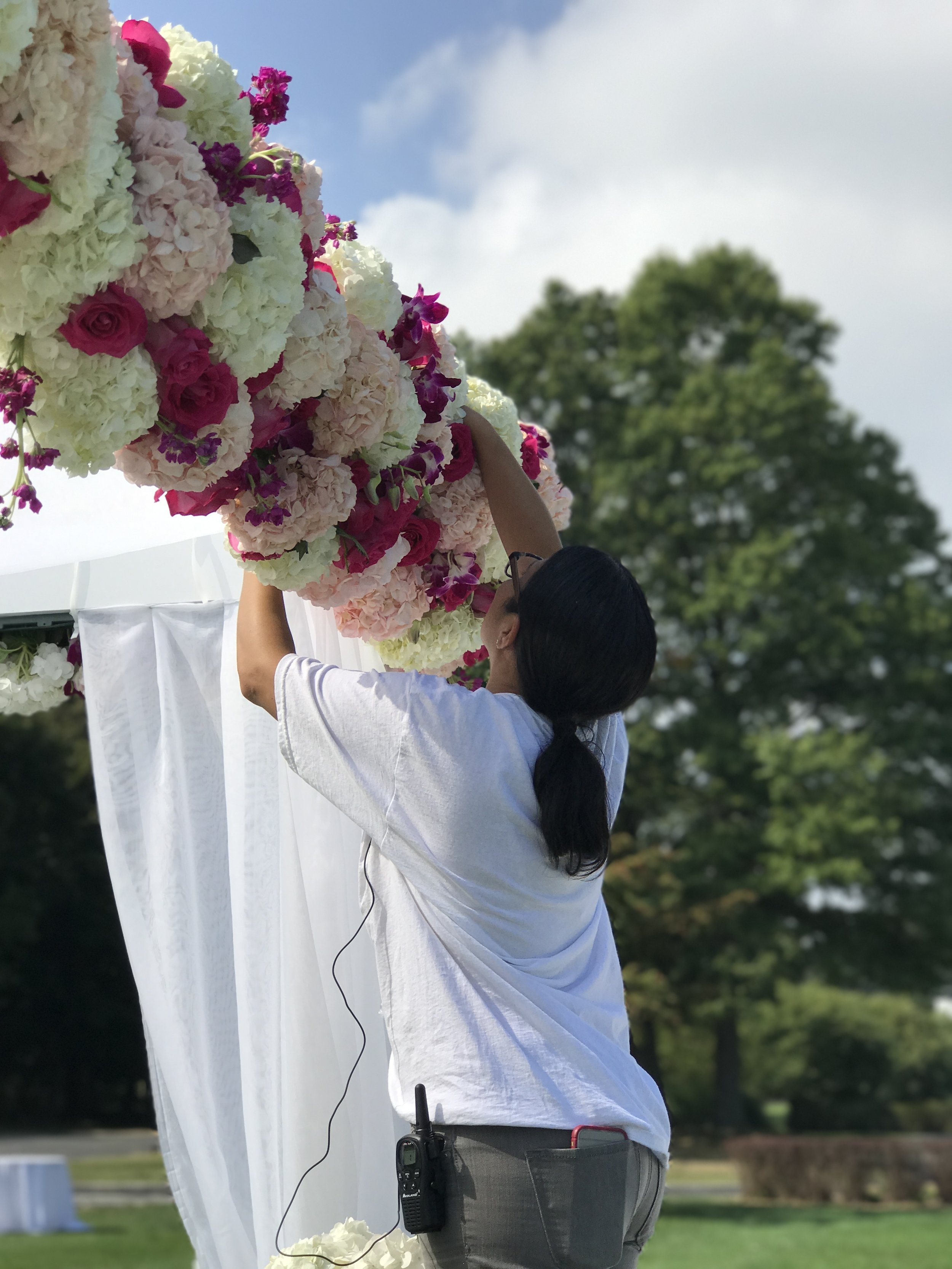 "This is me! I needed a tall ladder as I am somewhat short (4'9"" to be exact) lol. We were adding flowers and adjusting."