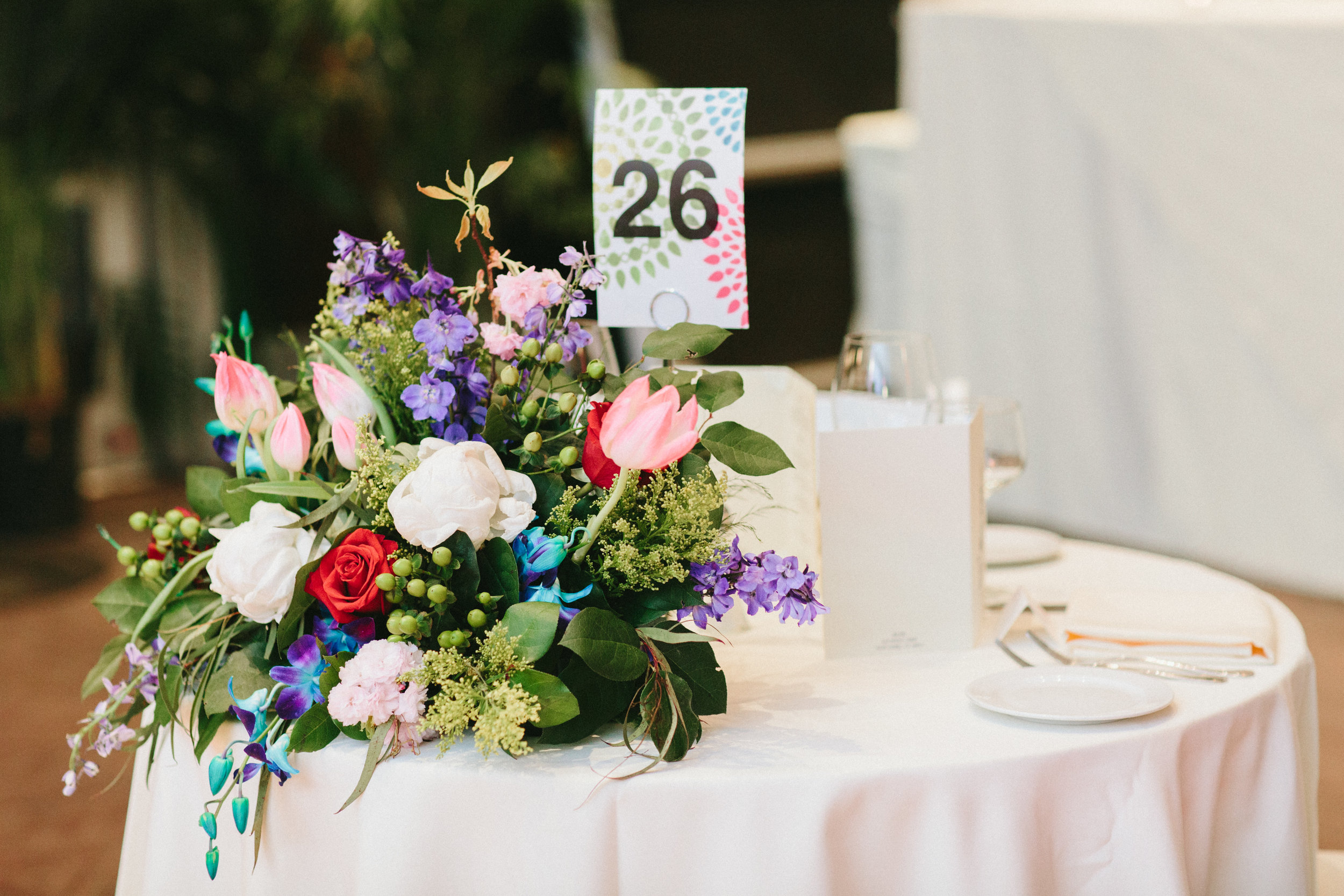 Evelisa Floral & Design | Colorful Sweetheart table flowers