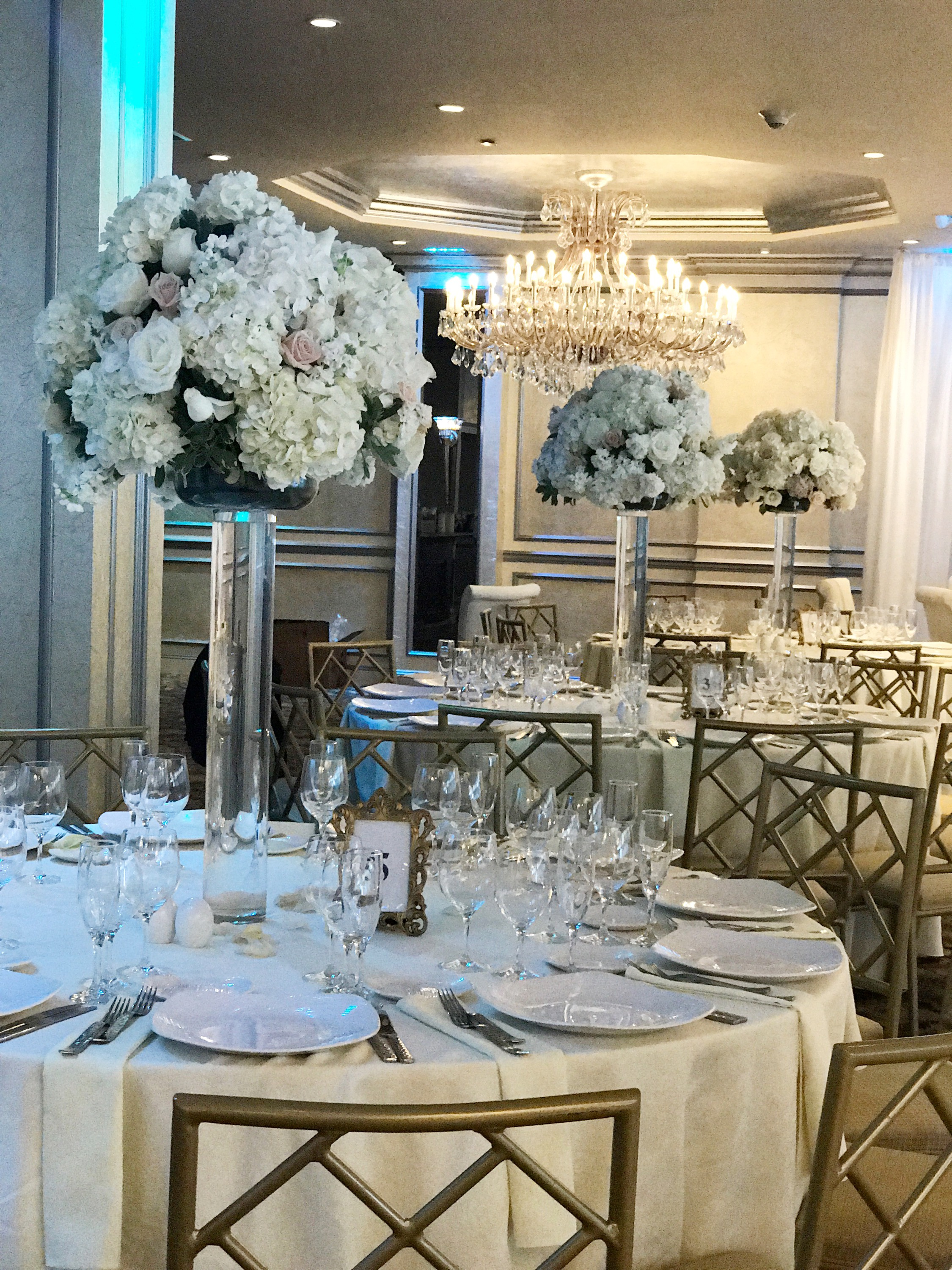 Evelisa Floral & Design | White flower centerpiece | elegant tall centerpieces | Surf Club