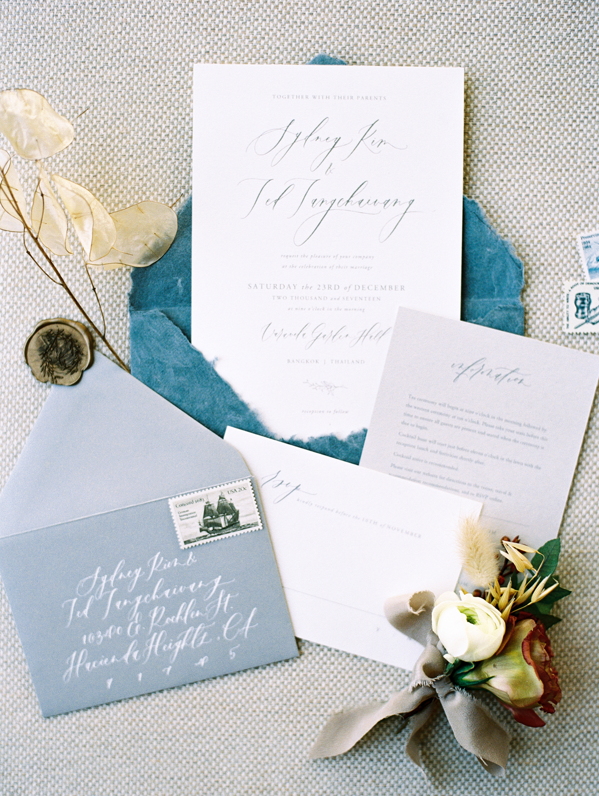 custom invitation suite with floral details