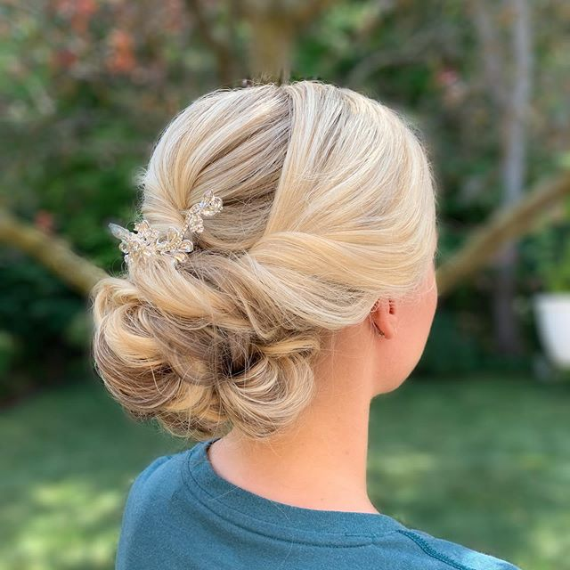 Loved getting to know Morgan and her mom at her trial run today! I will never tire of this classic bridal look! Morgan's beautiful blonde hair and her gorgeous hairpiece really make the updo pop!
