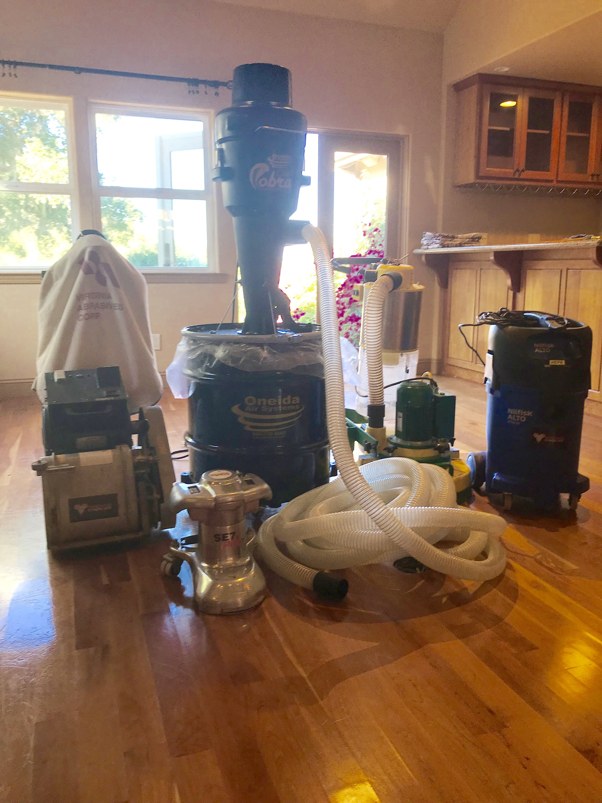 our state of the art sanding equipment and dust containment system