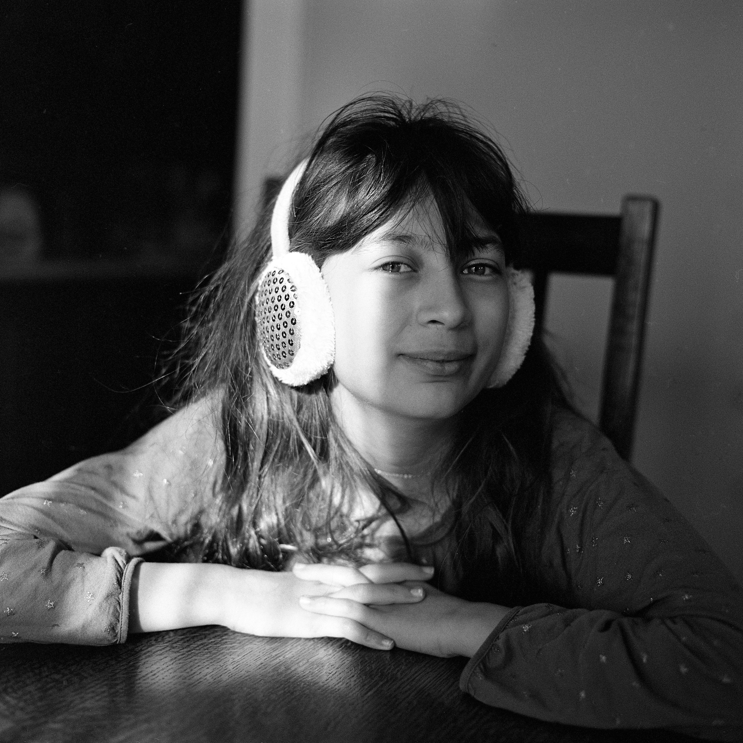 My daughter, Sofia, at the dining room table in early morning light. (Shot with a Rolleiflex 6008i medium format SLR camera and 80 mm f/2.8 lens on Tri-X 400 black-and-white film.)