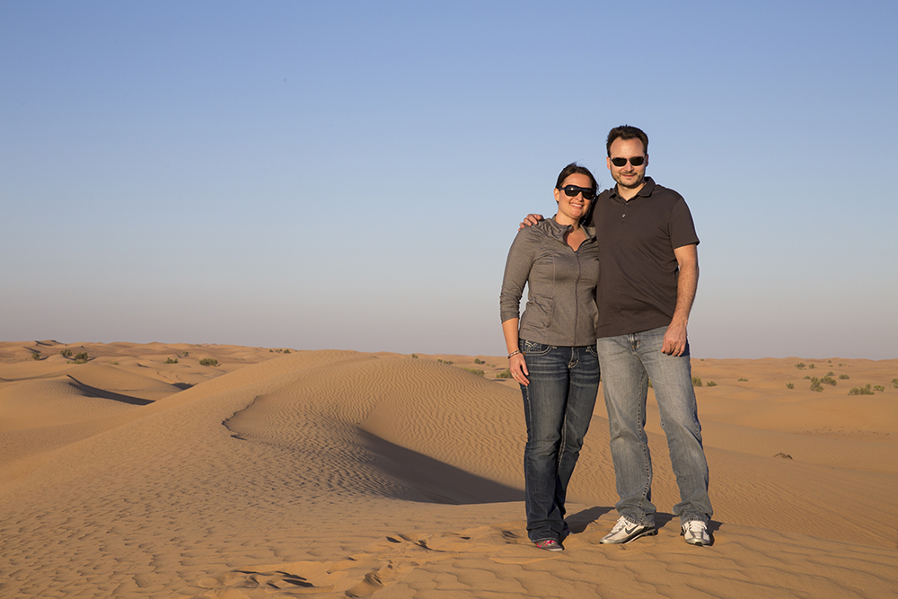 Josh with his wife Leslie on a sand dune in Dubai in early 2014 - photo taken by Photographie by A4