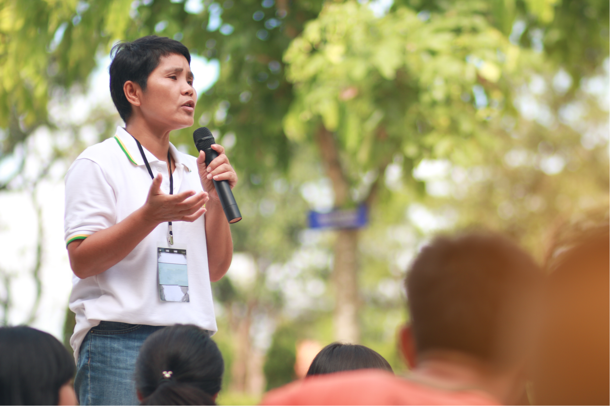 stock-photo-blurred-of-asian-thai-teachers-holding-a-microphone-teaching-students-and-speech-outside-the-531721099.jpg
