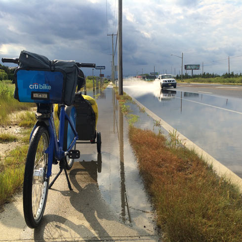 A flooded roadway and sidewalk makes for a tough crossing in West Atlantic City, NJ