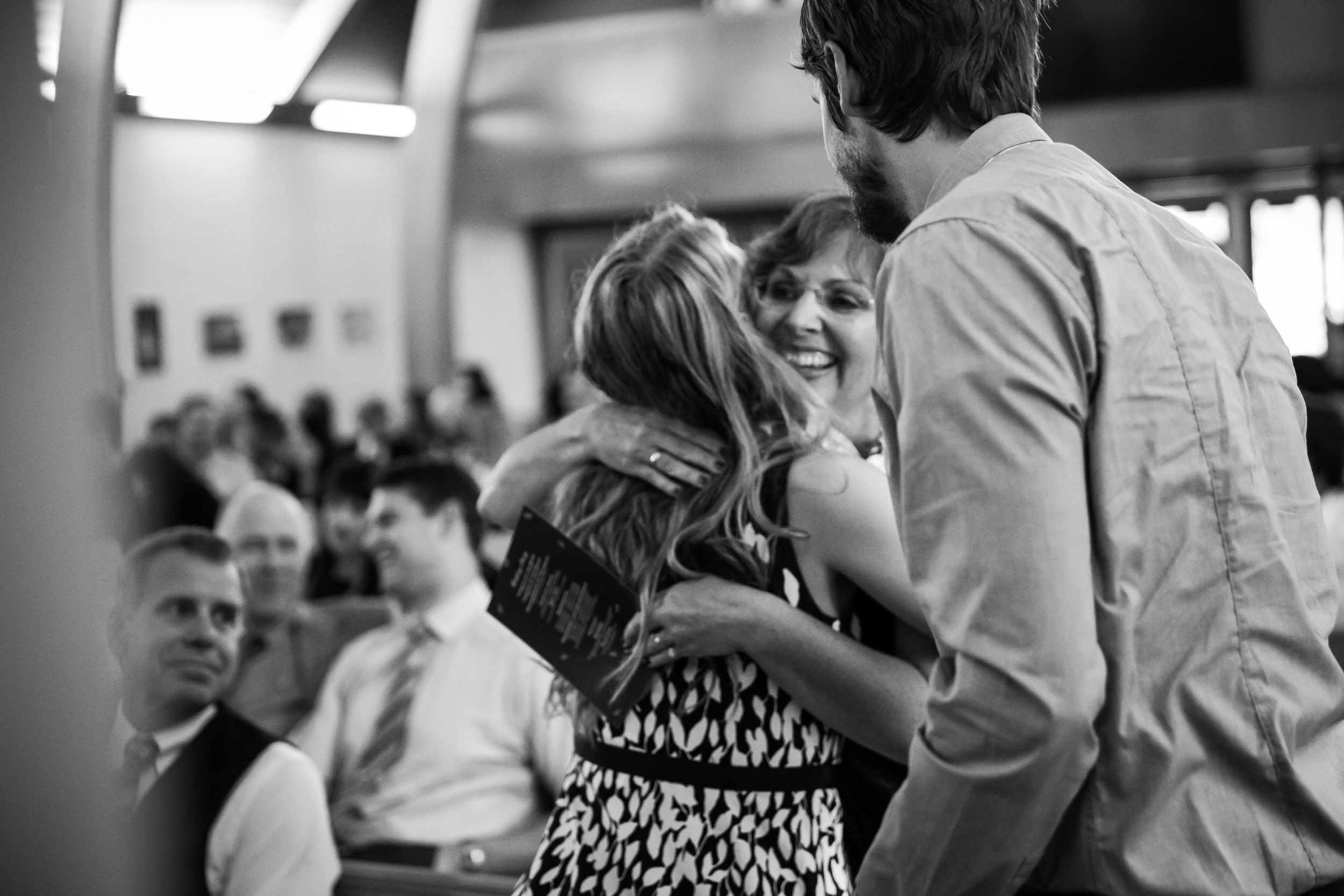 Seattle Community Church Wedding Photography | By G. Lin Photography | Mother of the bride hugging guest