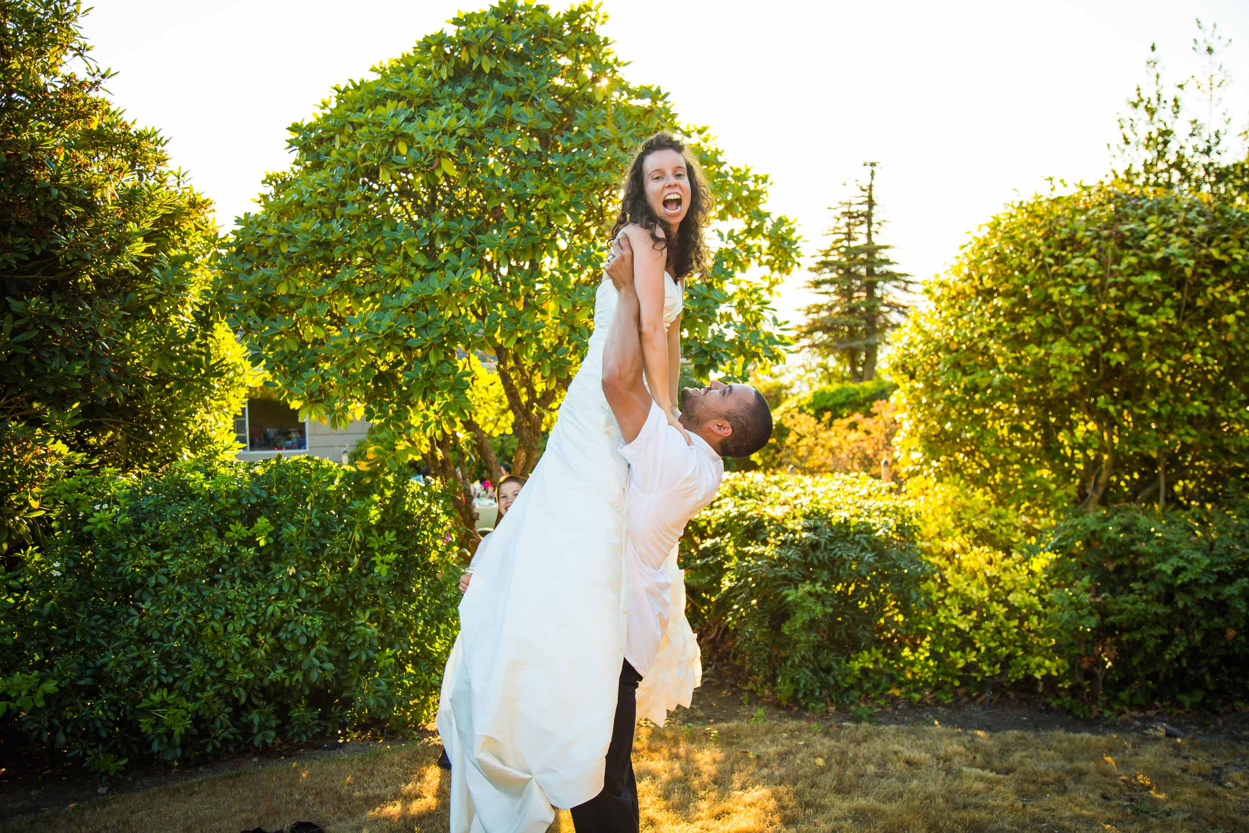 Seattle Wedding Photographer | By G. Lin Photography | Groom holding up bride in garden wedding