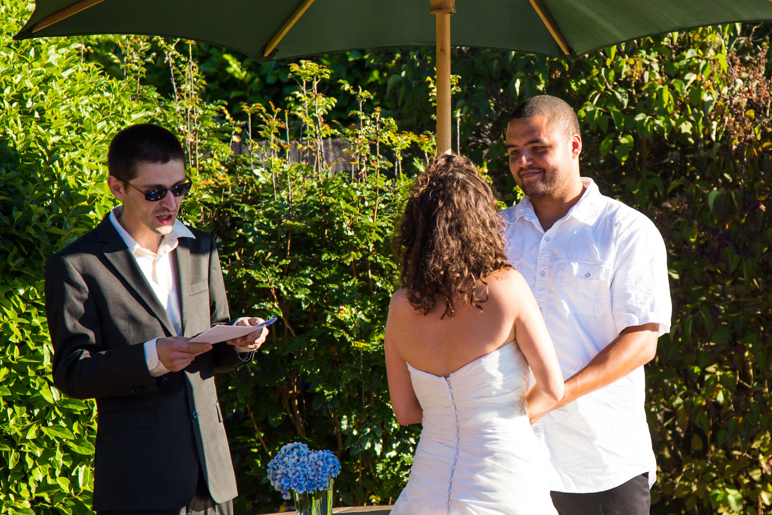 Seattle Wedding Photographer | By G. Lin Photography | Officiant reading to bride and groom