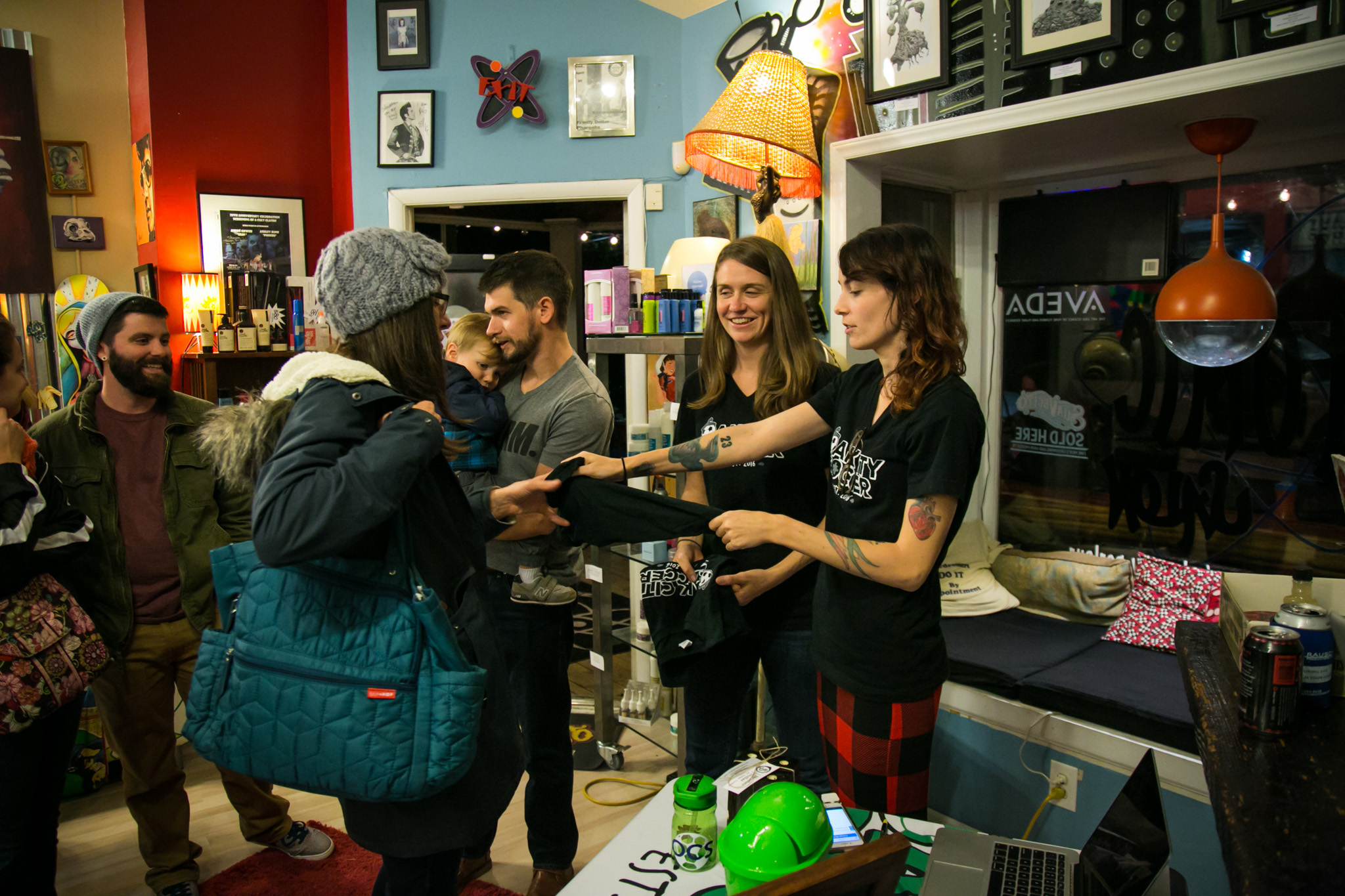 Raleigh Event Photographer | G. Lin Photography | Guests purchasing items during event