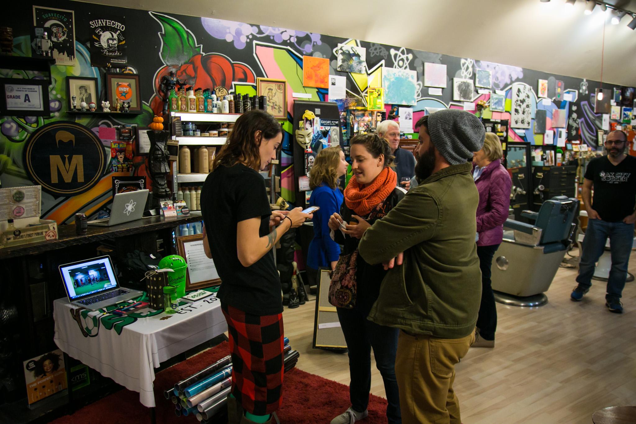 Raleigh Event Photographer | G. Lin Photography | Woman doing a transaction inside salon