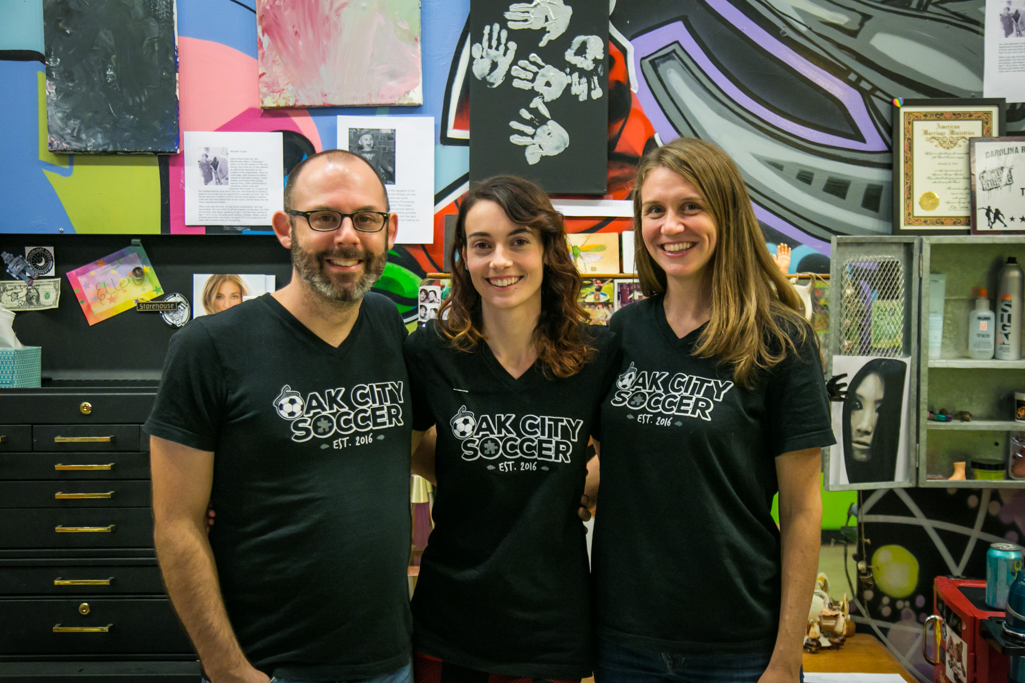 Raleigh Event Photographer | G. Lin Photography | Group photo of executive team standing in front of art work