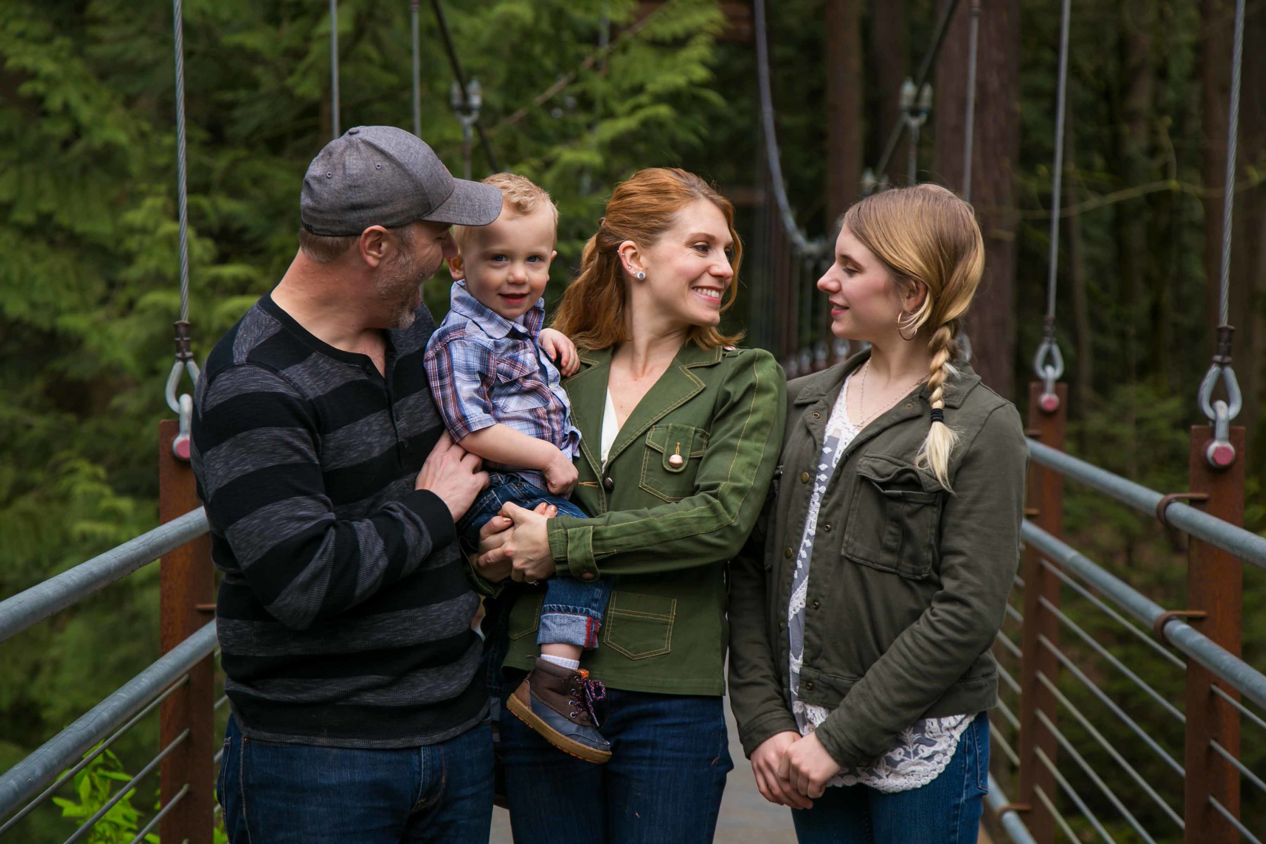 Seattle Family Photographer | G. Lin Photography | Family standing on bridge and looking at each other