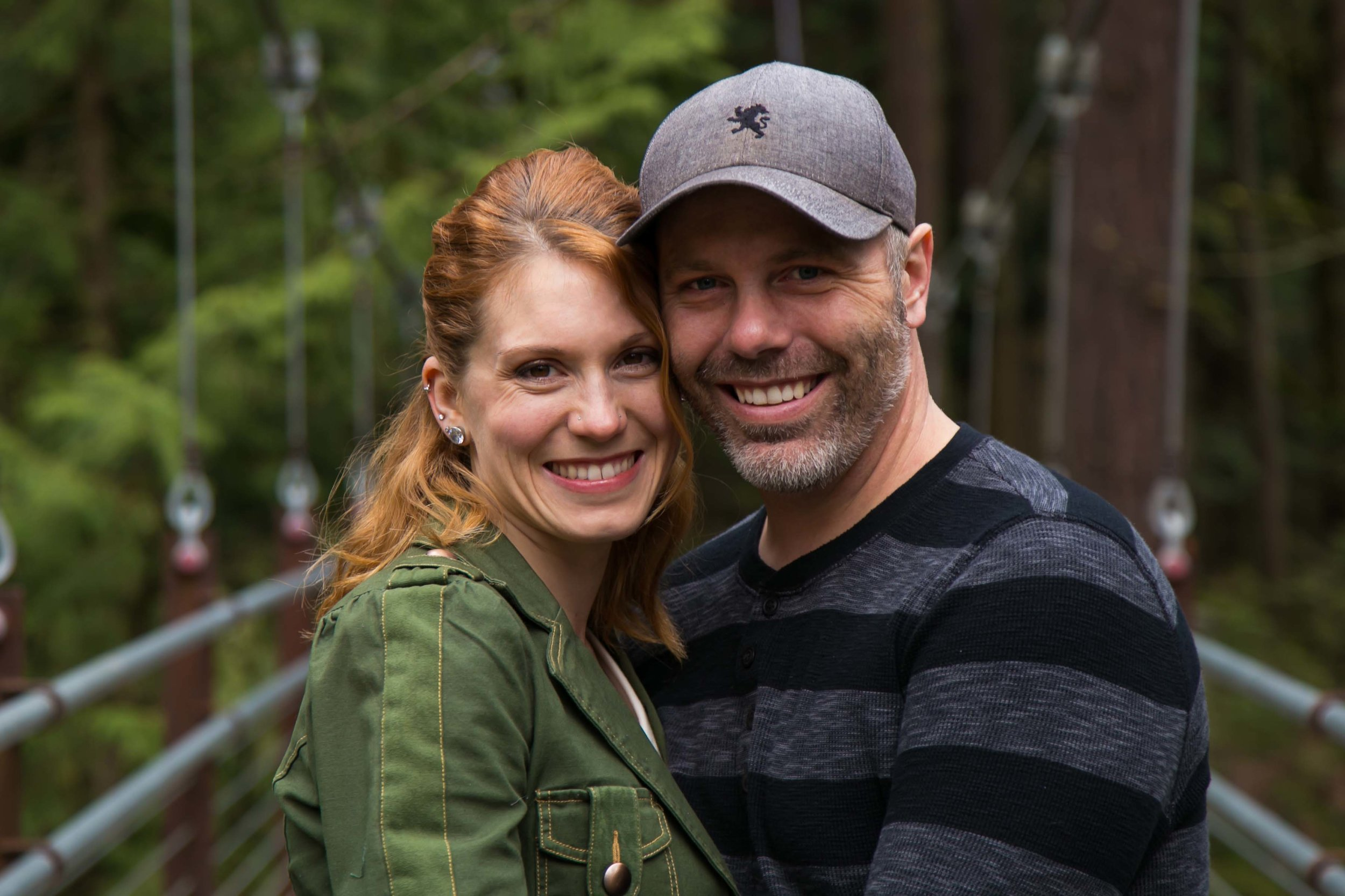 Seattle Family Photographer | G. Lin Photography | Couple standing on bridge and smiling at camera