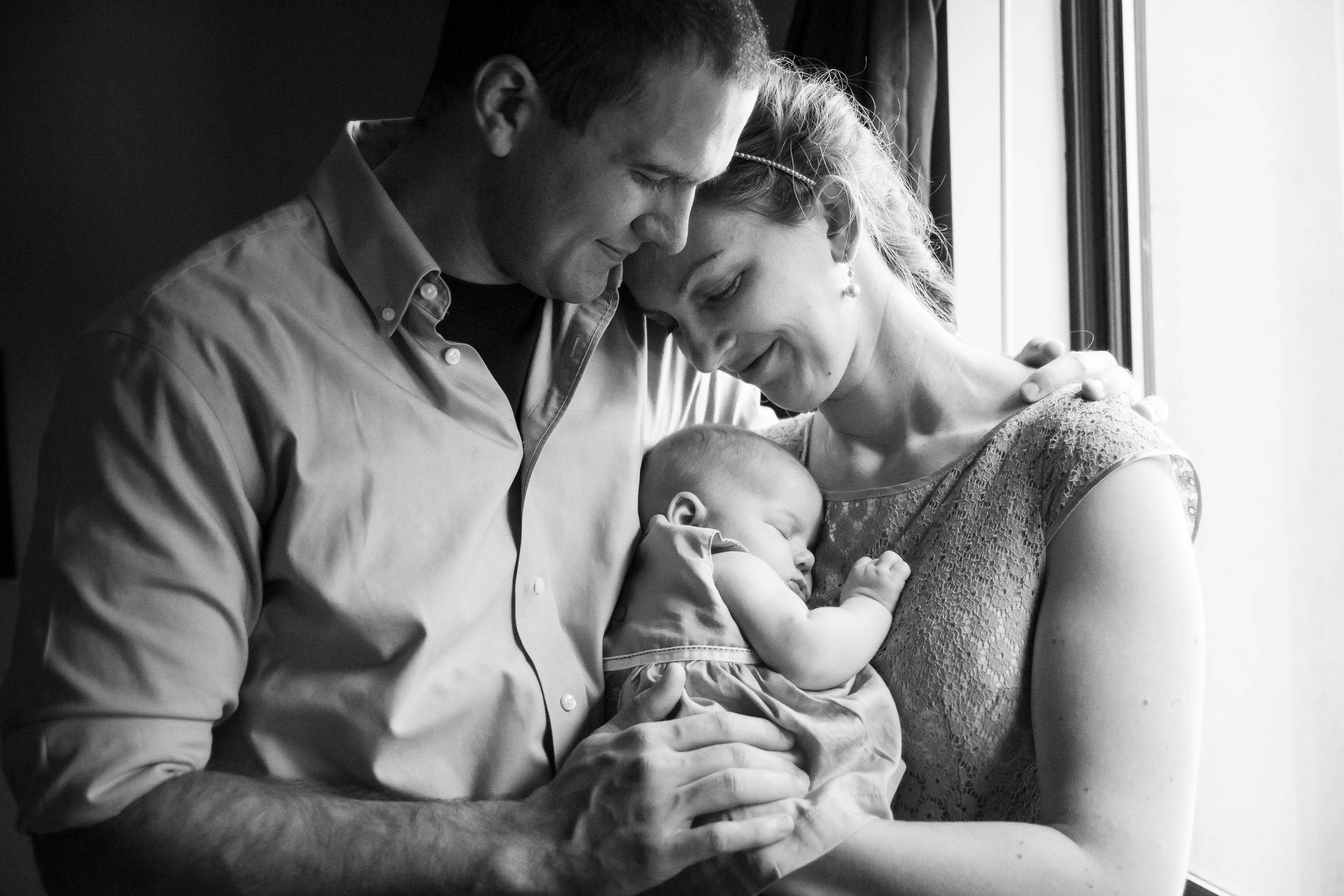Seattle Family Photographer   By G. Lin Photography   Black and white image of parents holding baby