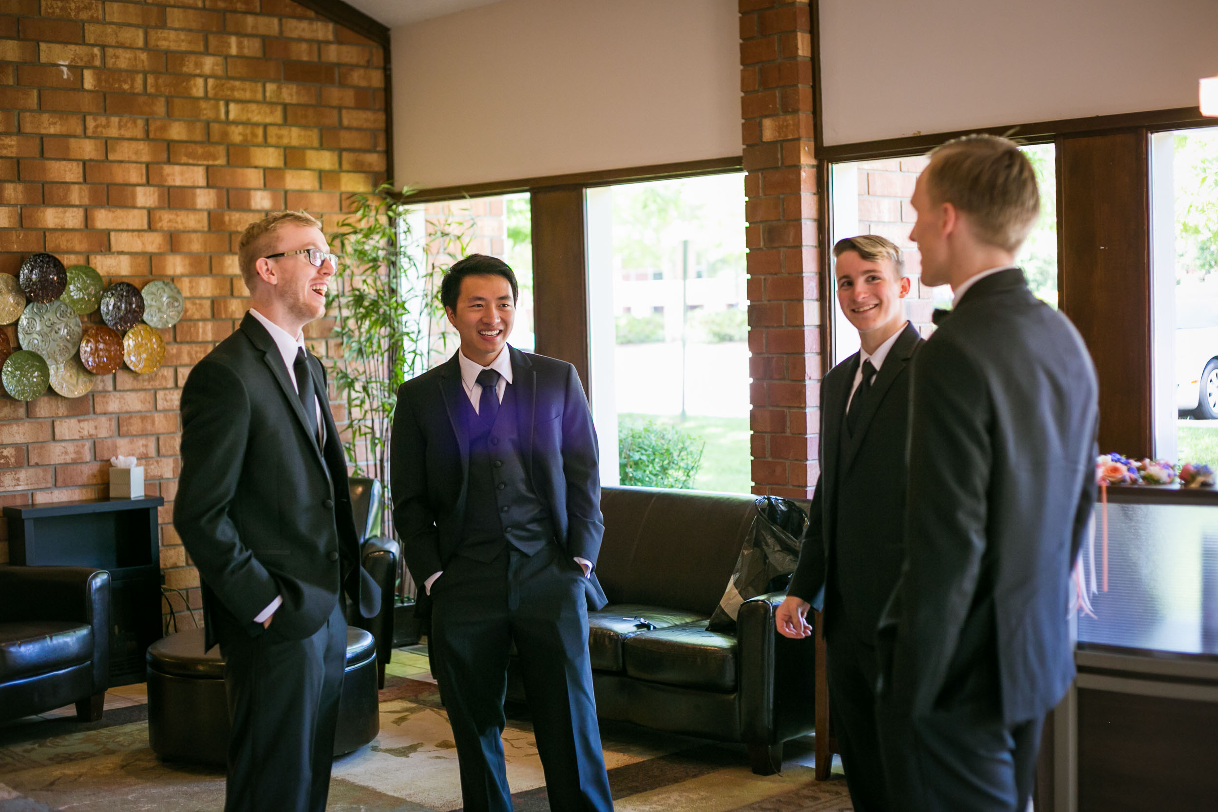Raleigh Wedding Photographer | G. Lin Photography | Groomsmen standing in lobby and laughing