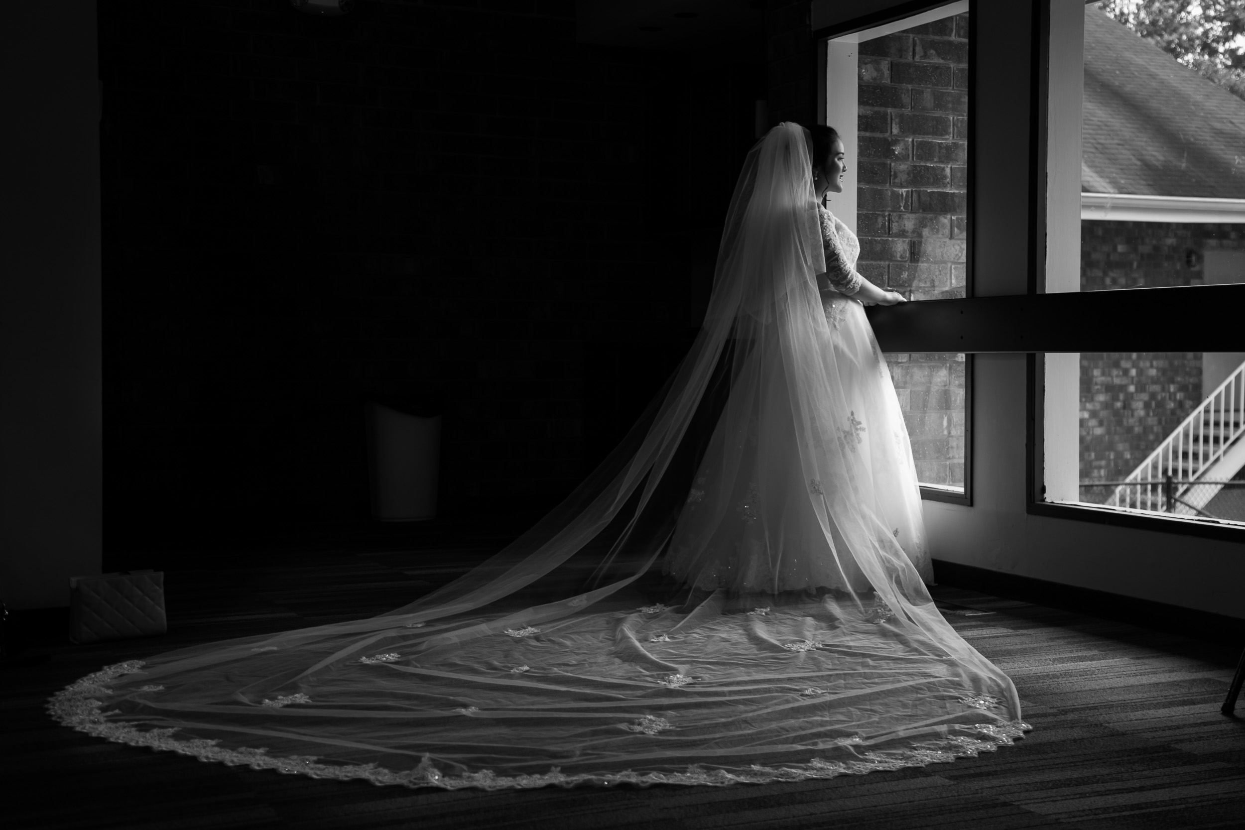 Raleigh Wedding Photographer | G. Lin Photography | Bride standing by window looking outside