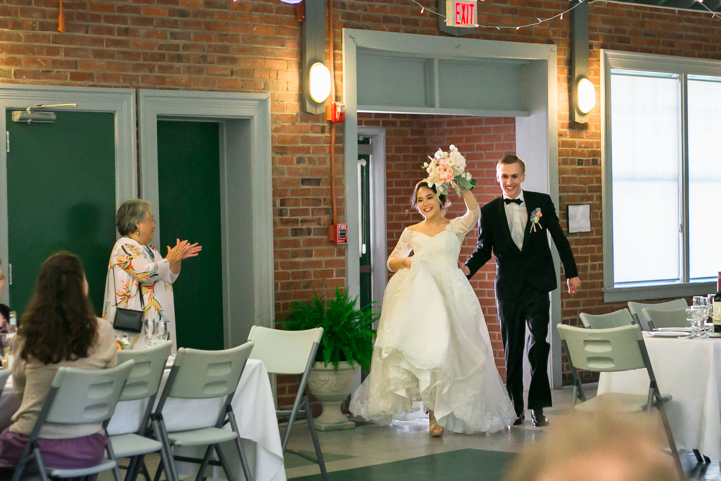Raleigh Wedding Photographer | G. Lin Photography | Bride and groom entering the reception