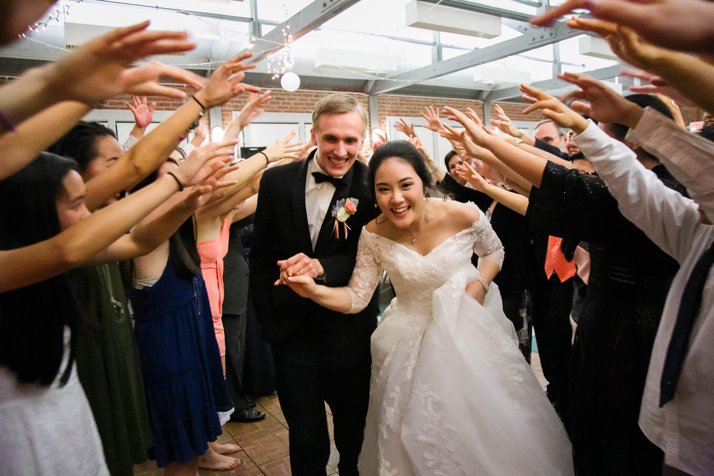 Raleigh Wedding Photographer   G. Lin Photography   Bride and groom exiting wedding