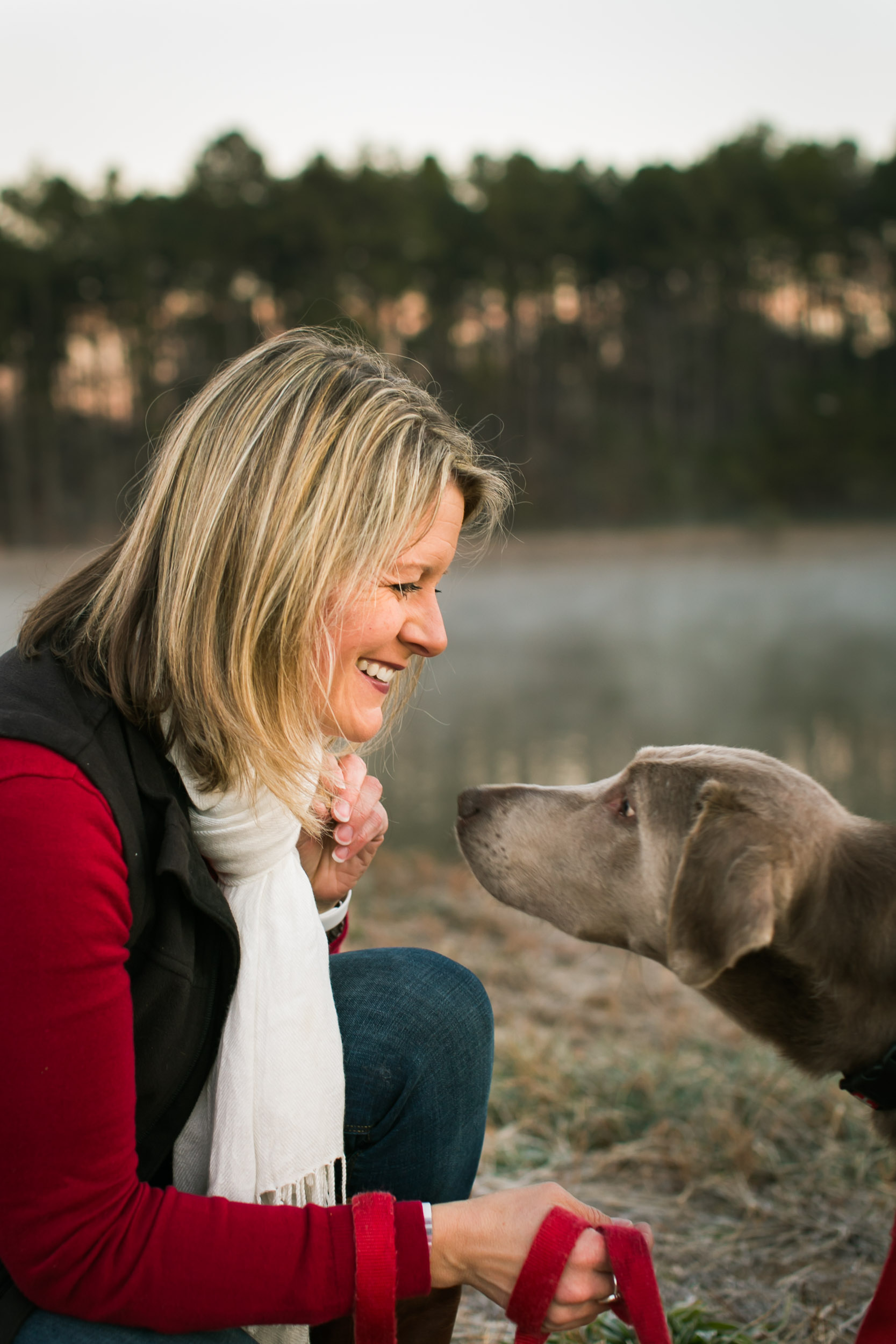 Durham Family Photographer | G. Lin Photography | Woman and dog smiling in park