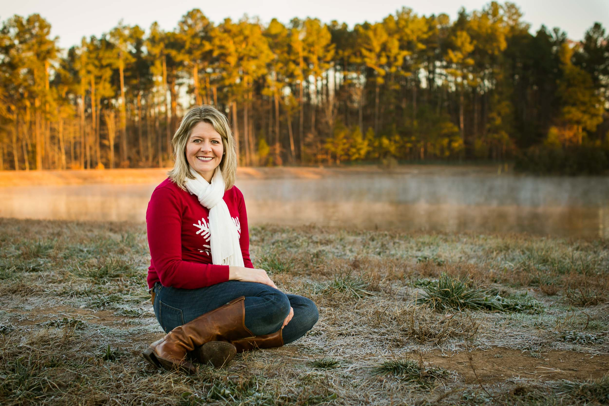 Durham Family Photographer | G. Lin Photography | Woman sitting by lake smiling at camera