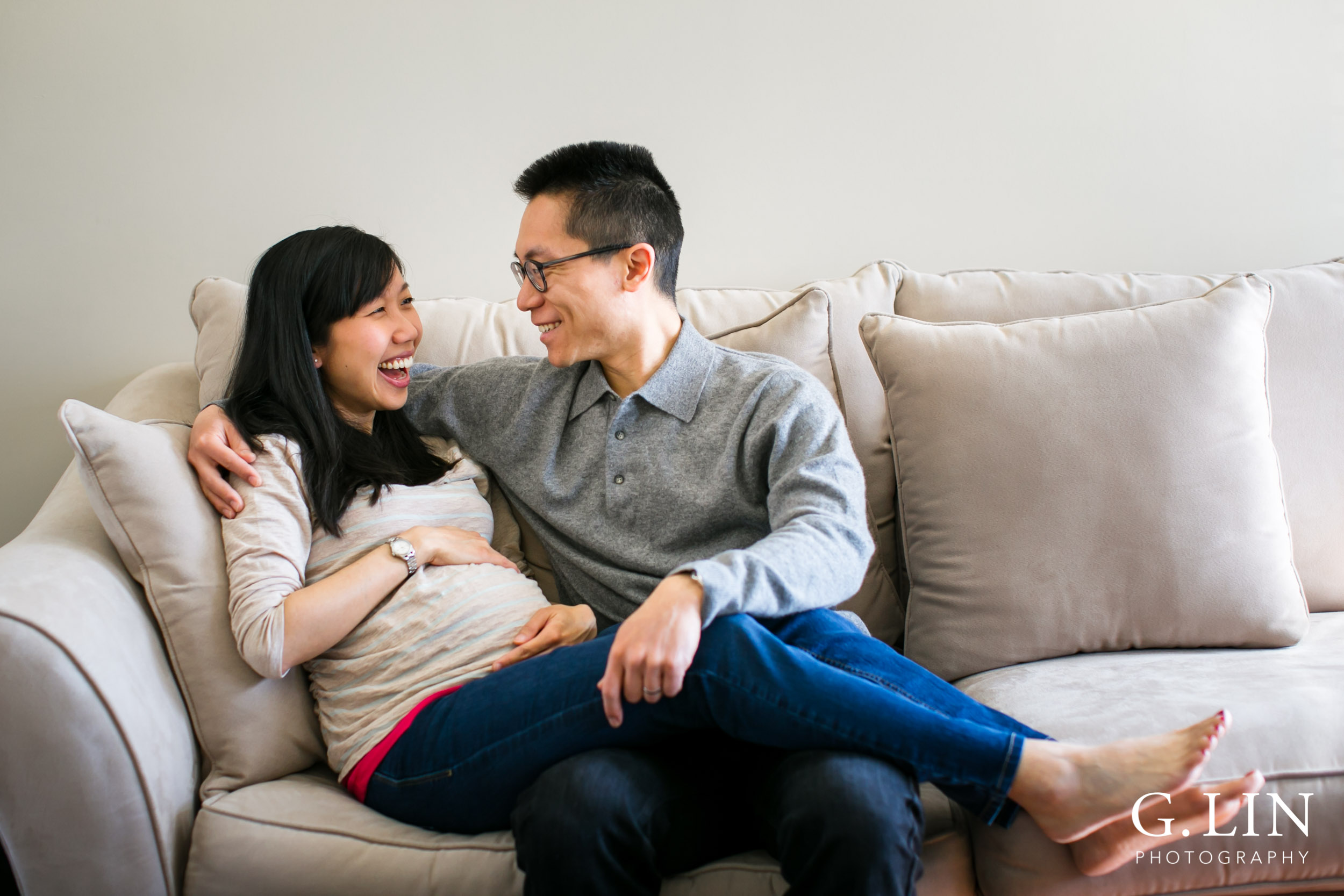 Durham Maternity Photography | G. Lin Photography | Couple sitting on couch and laughing
