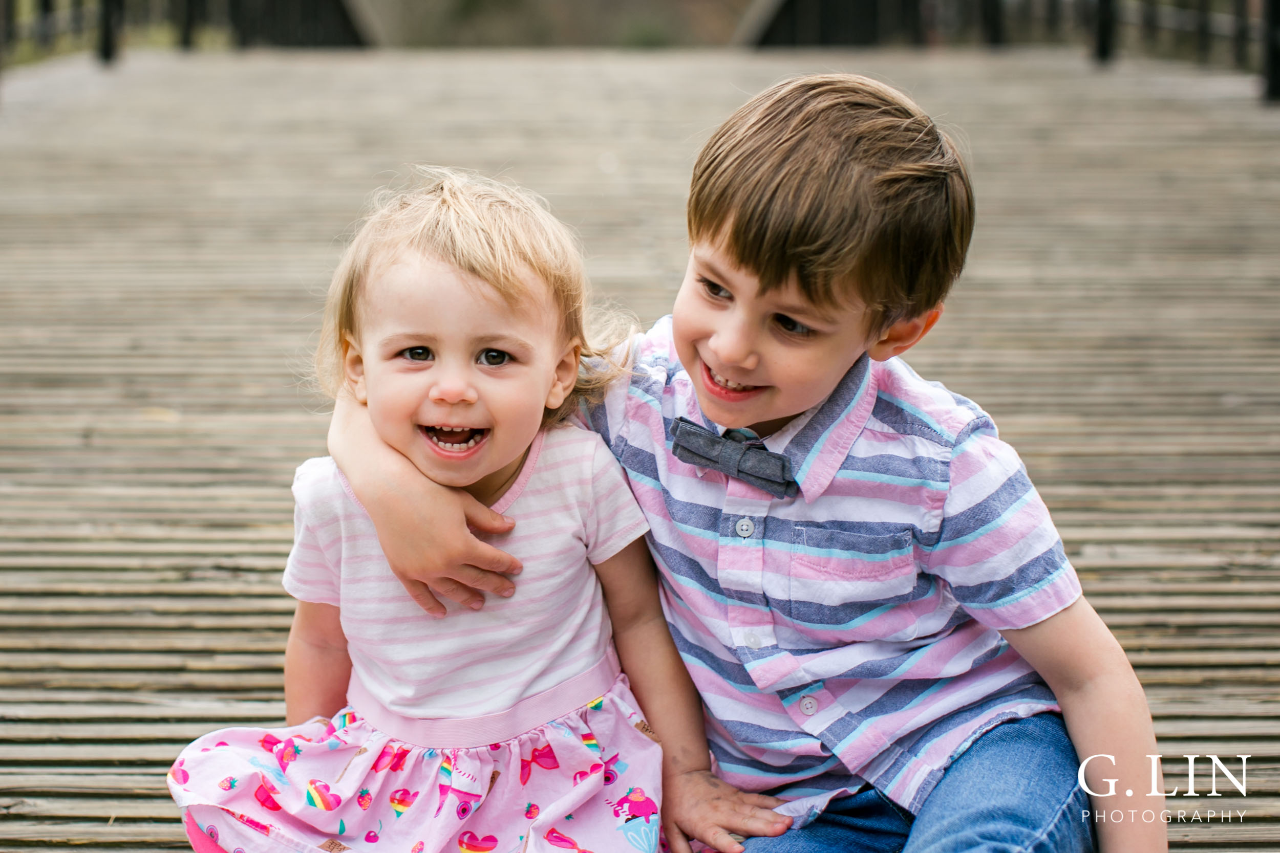 Raleigh Family Photographer | G. Lin Photography | Children sitting on ground smiling
