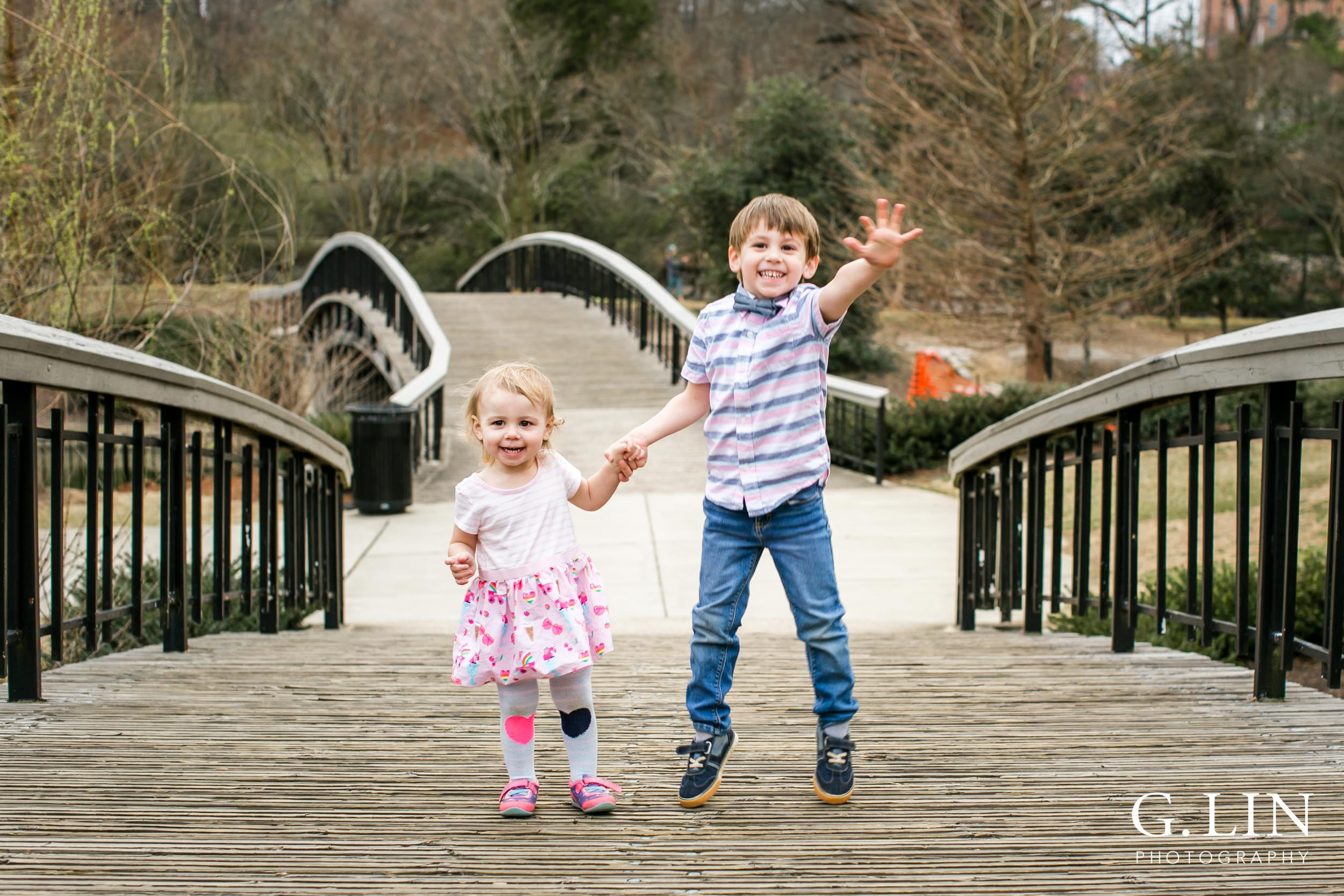 Raleigh Family Photographer | G. Lin Photography | Children holding hands and jumping