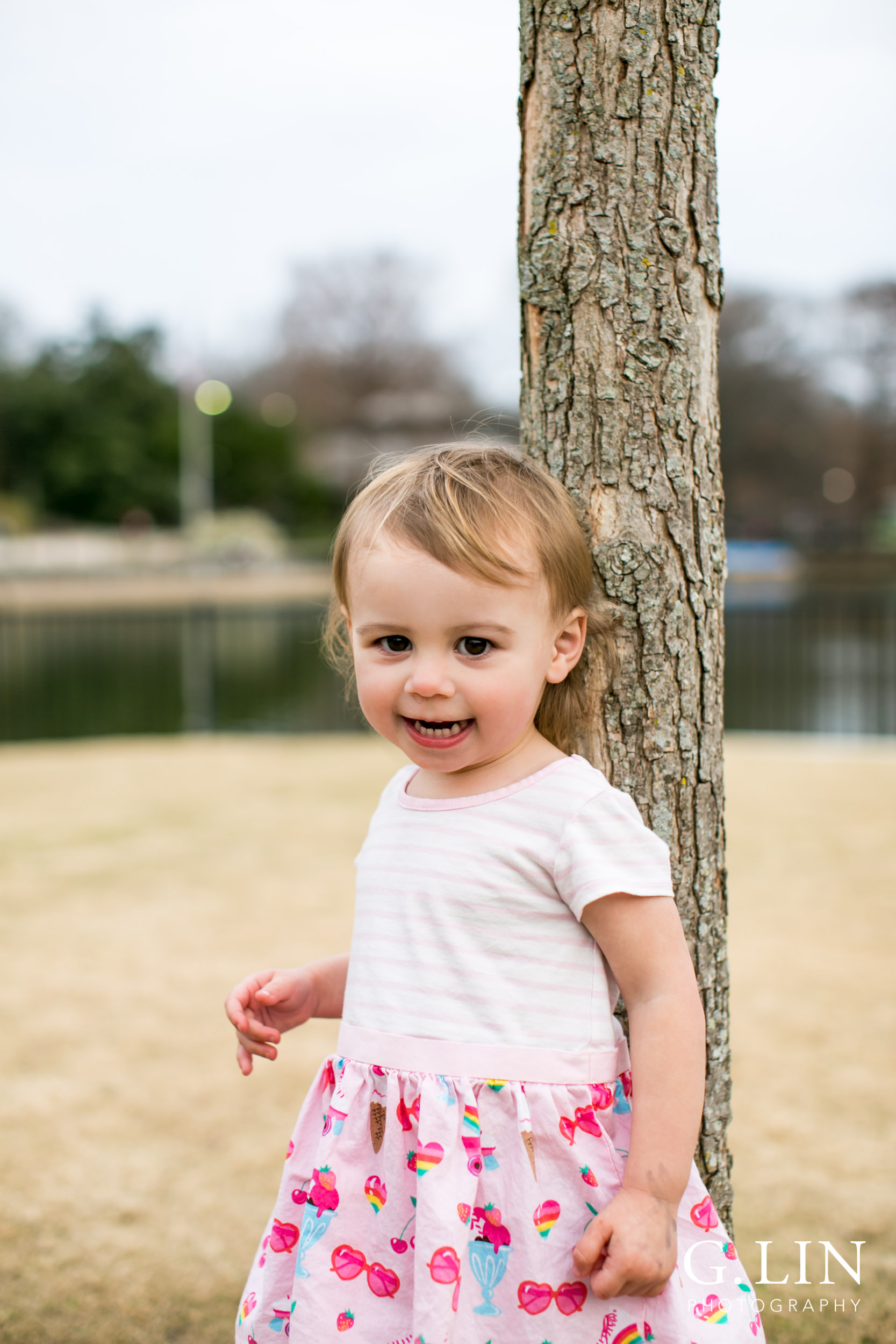 Raleigh Family Photographer | G. Lin Photography | Girl standing in field and smiling
