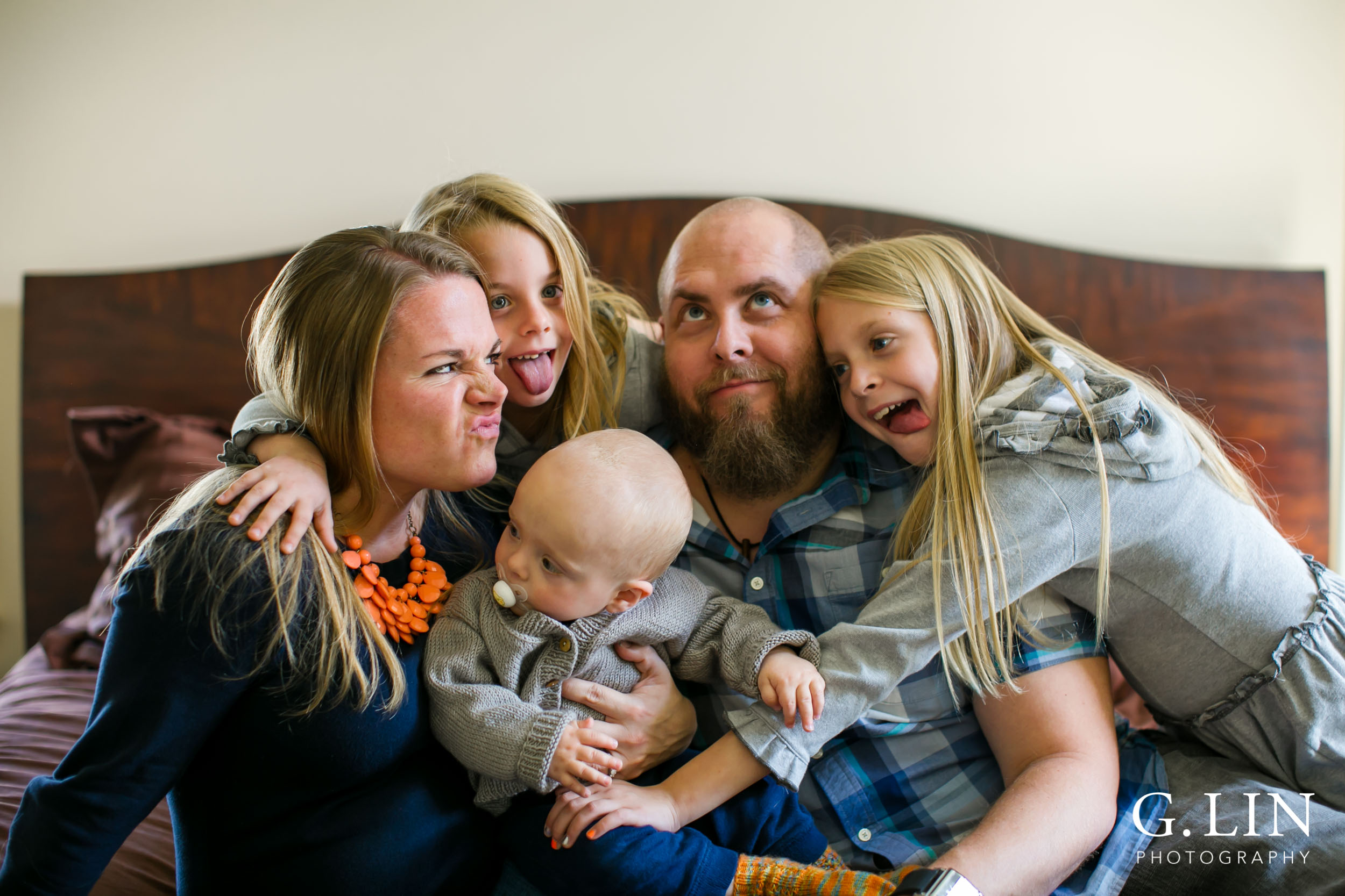 Silly faces made by family for portrait session