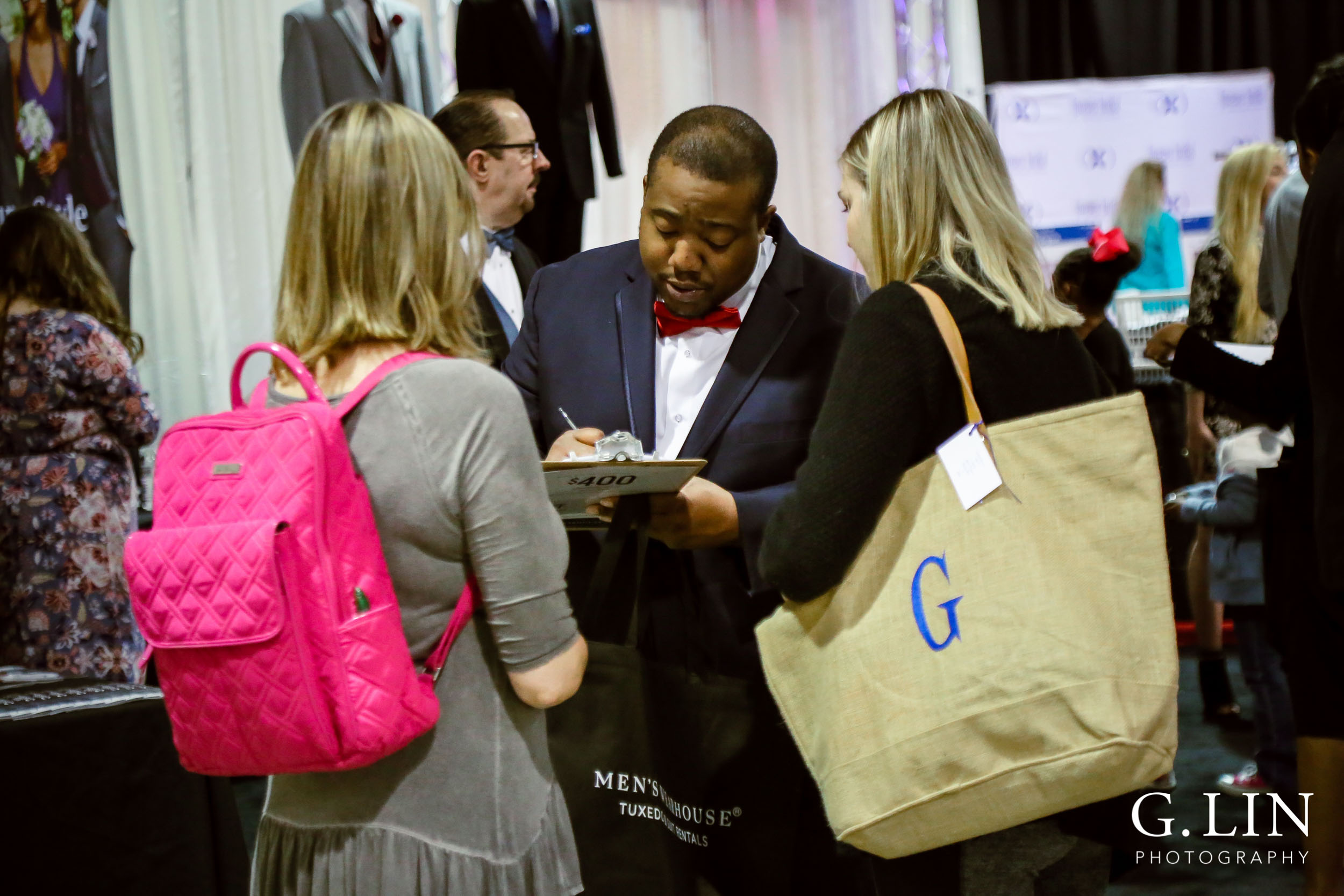 Raleigh Event Photographer | G. Lin Photography | Vendor helping brides at wedding show