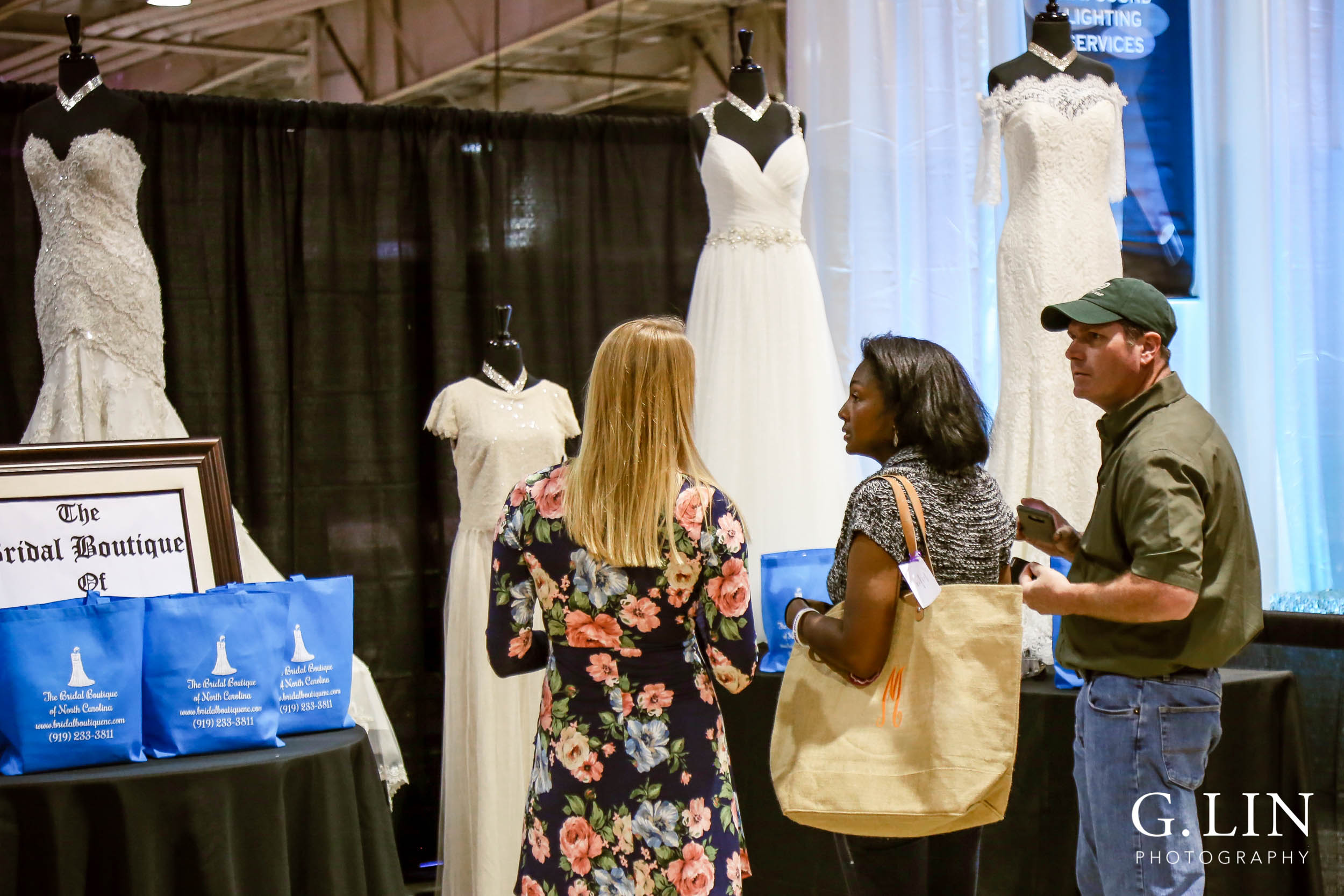 Raleigh Event Photographer | G. Lin Photography | Vendor helping bride and groom with wedding gowns