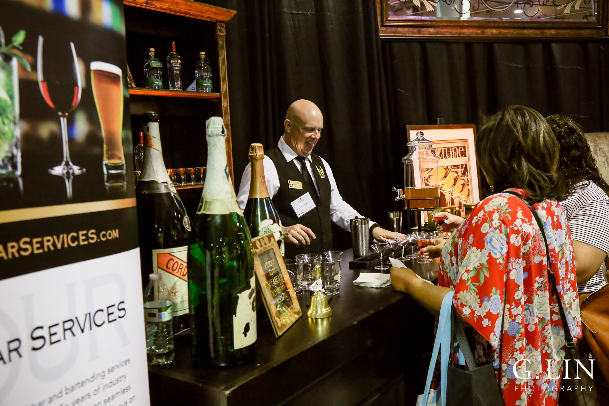 Raleigh Event Photographer | G. Lin Photography | Vendor pouring drinks for guests at wedding show