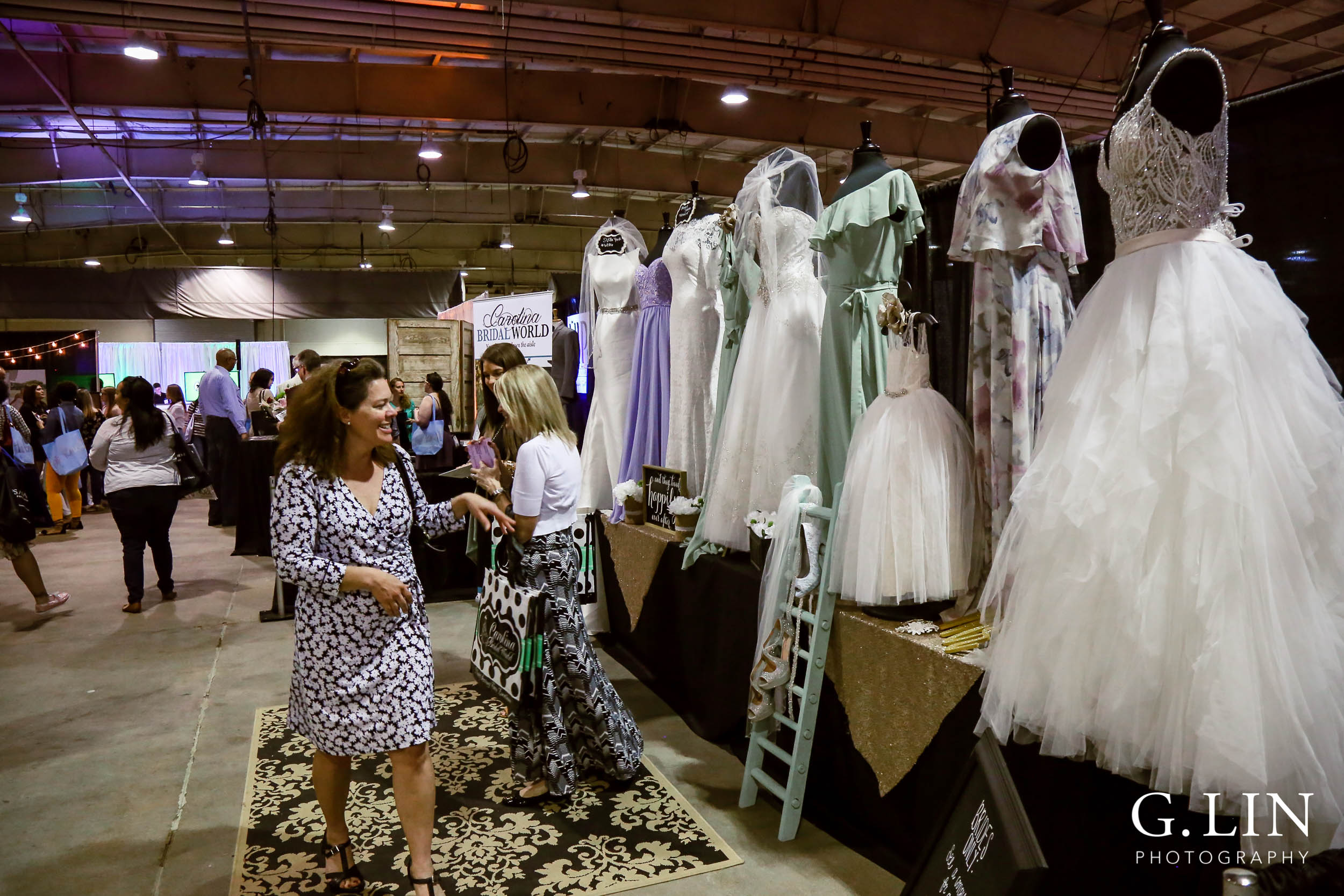 Raleigh Event Photographer | G. Lin Photography | Guest looking at wedding dresses at bridal show