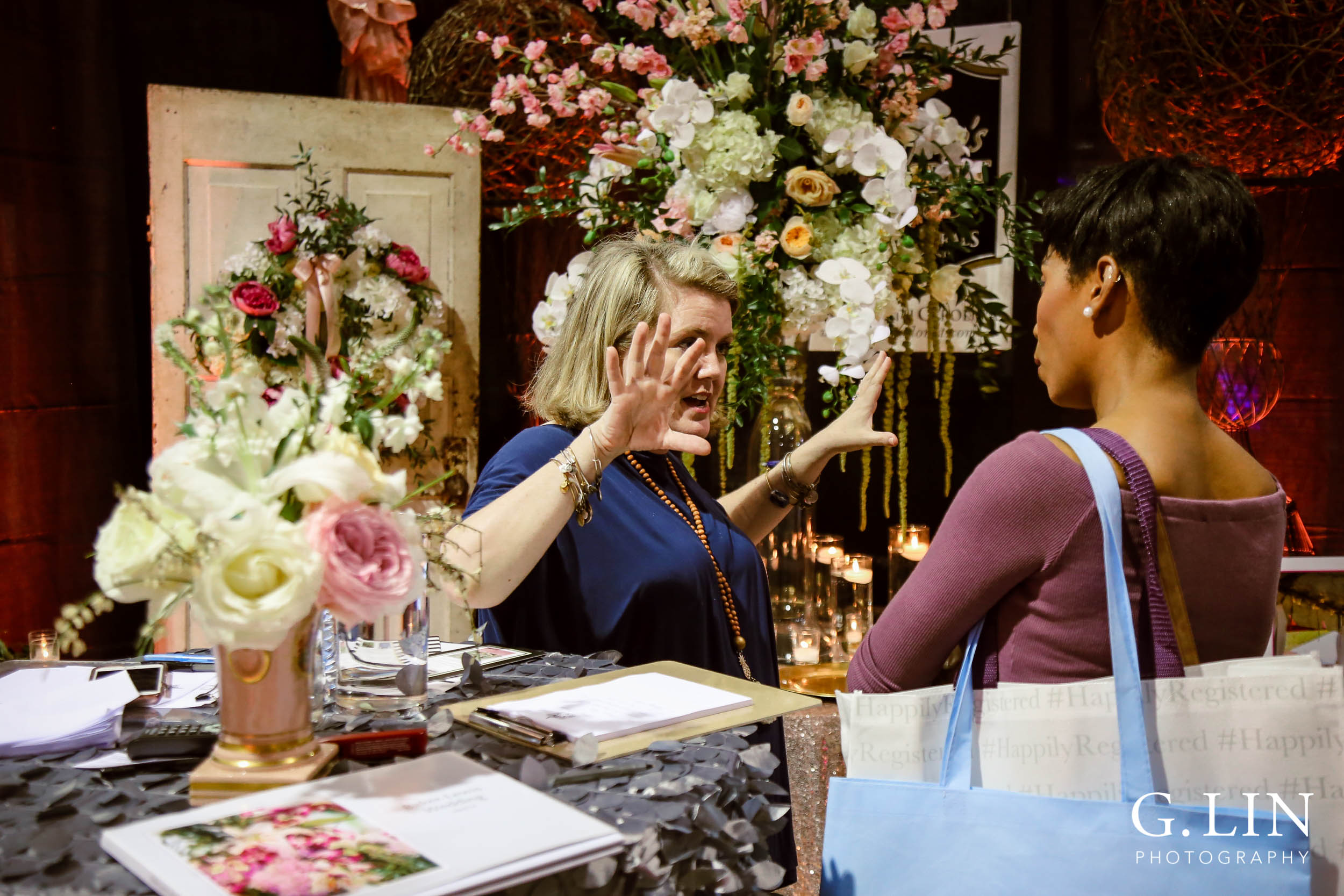 Raleigh Event Photographer | G. Lin Photography | Woman and bride talking to each other at booth