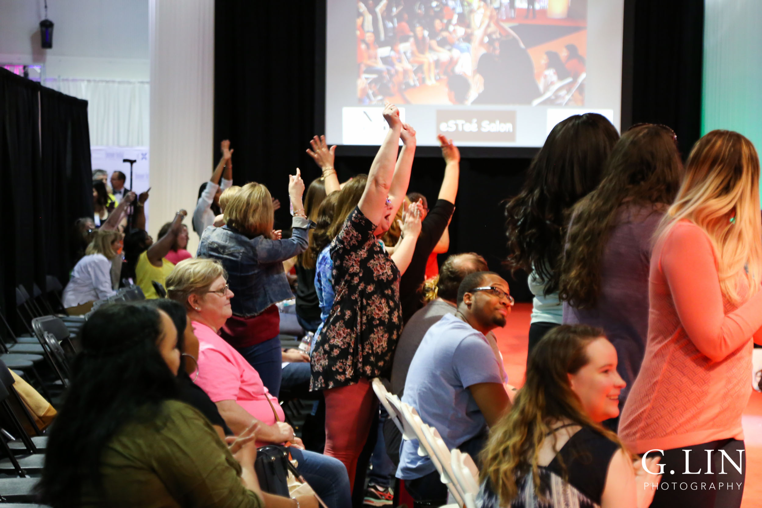 Raleigh Event Photographer | G. Lin Photography | Guests cheering during fashion show