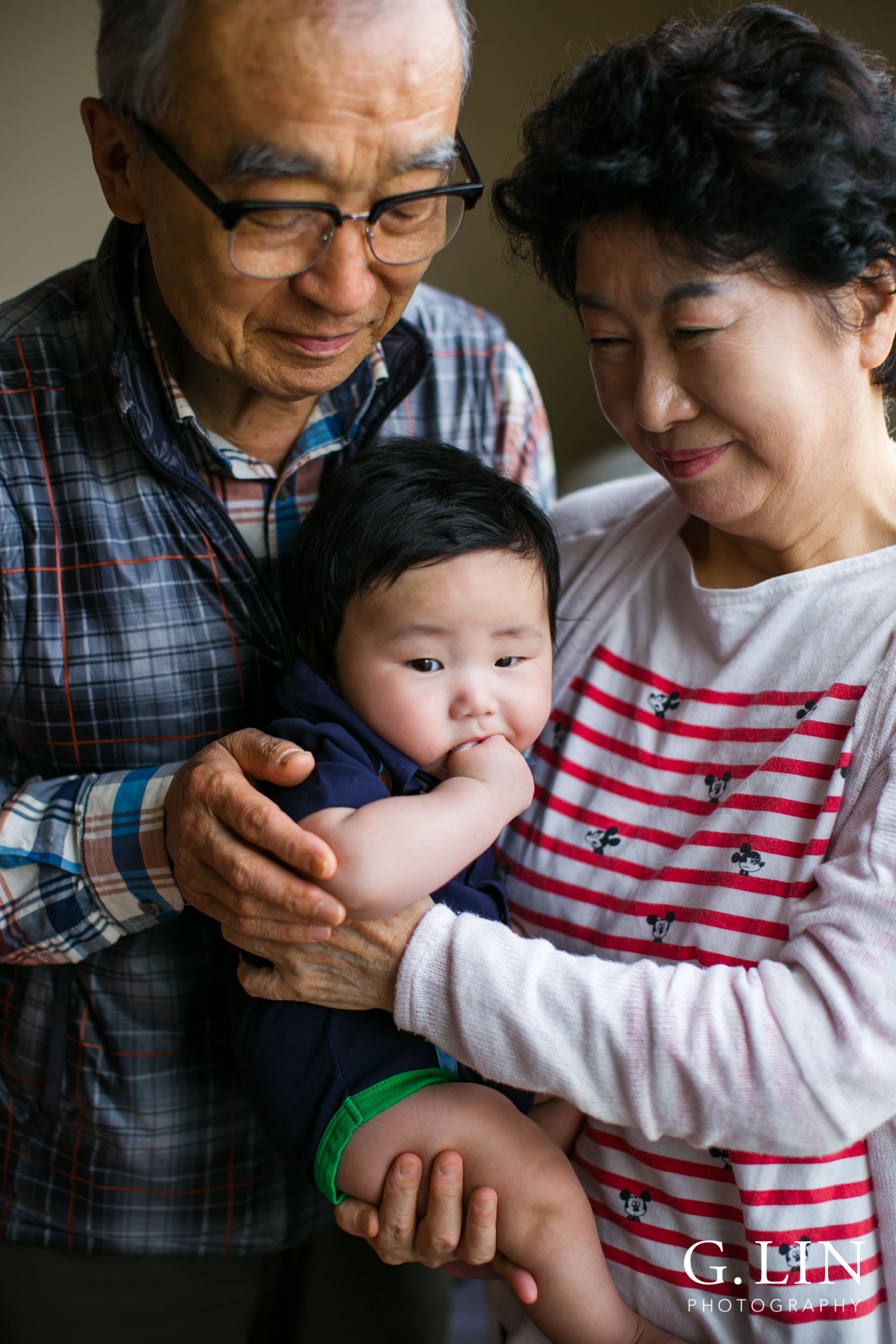 Durham Family Photographer | G. Lin Photography | Grandparents at home holding baby