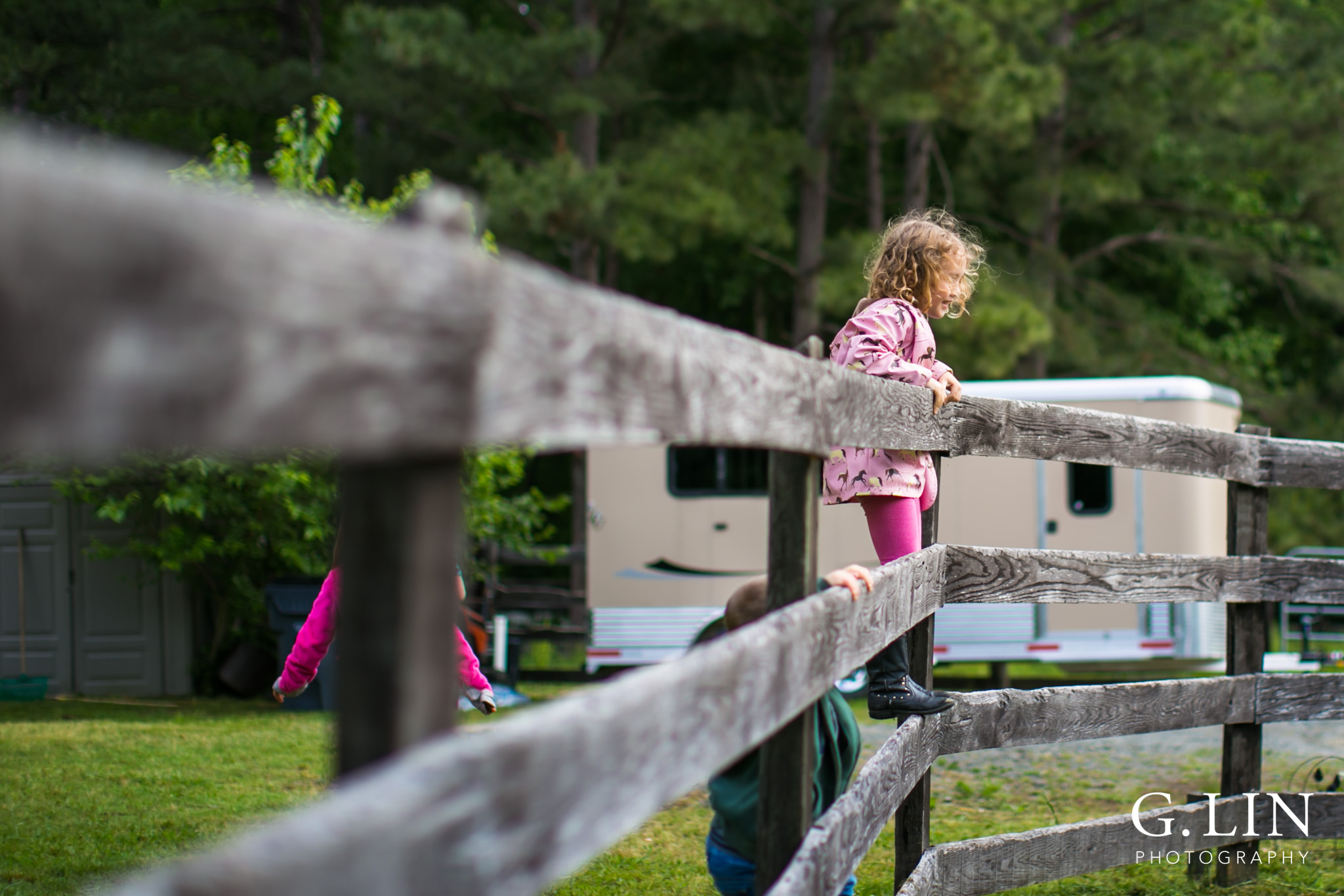 G. Lin Photography | Raleigh Event Photographer | Girl on fence looking around