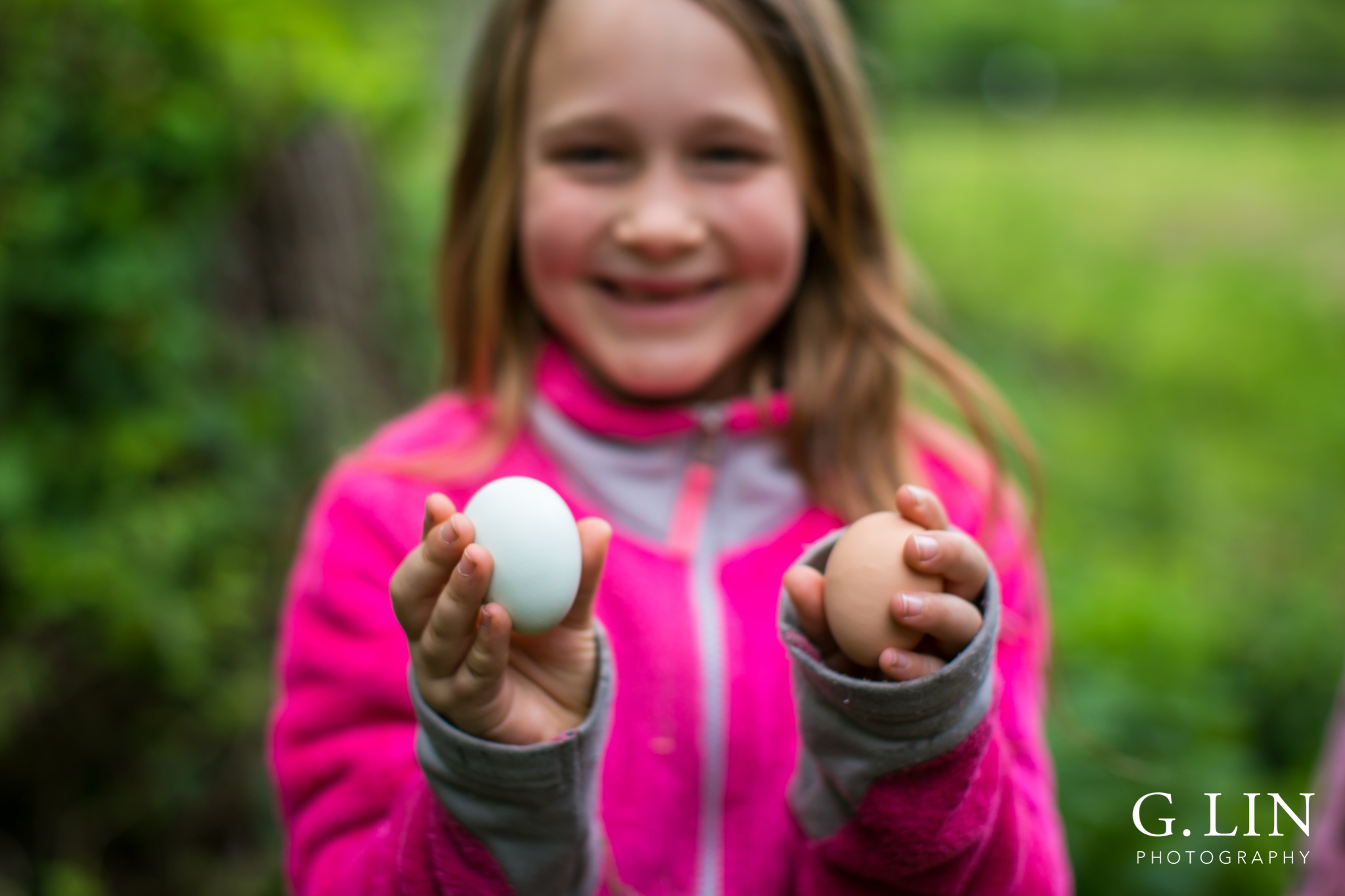 G. Lin Photography | Raleigh Event Photographer | Girl holding two eggs on farm