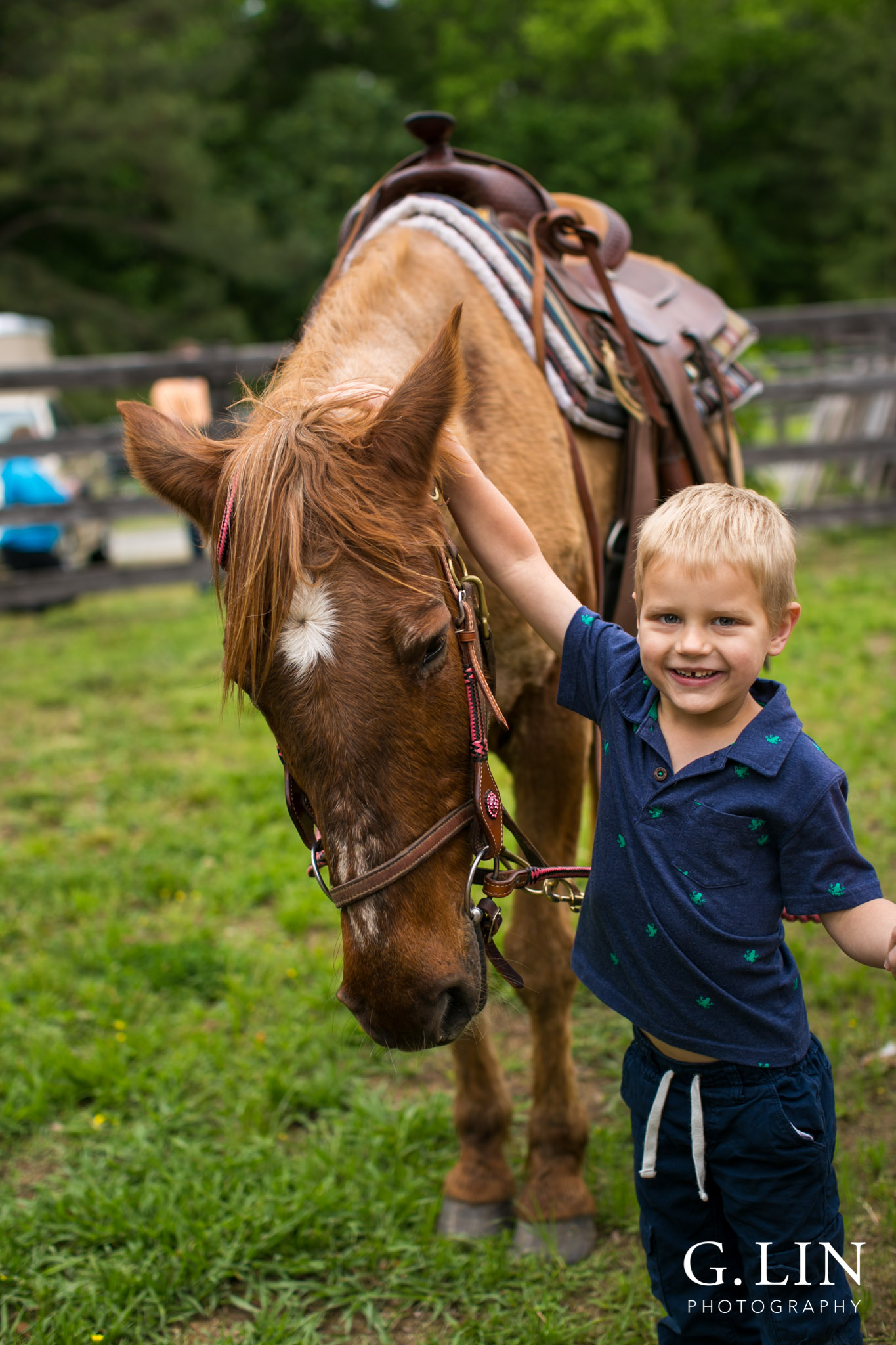 G. Lin Photography | Raleigh Event Photographer | Boy standing next to horse and smiling at camera