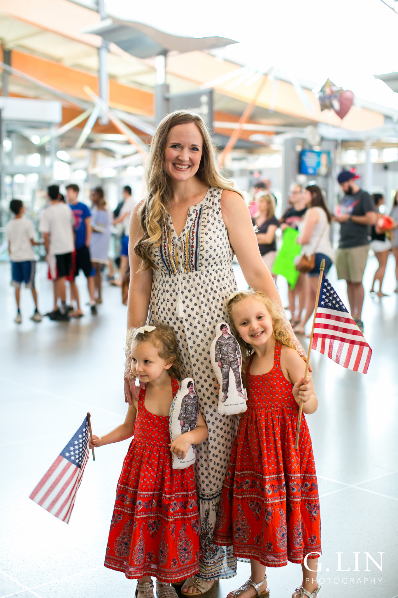 Raleigh Family Photographer | G. Lin Photography | Little girls with their mom smiling and standing in the airport