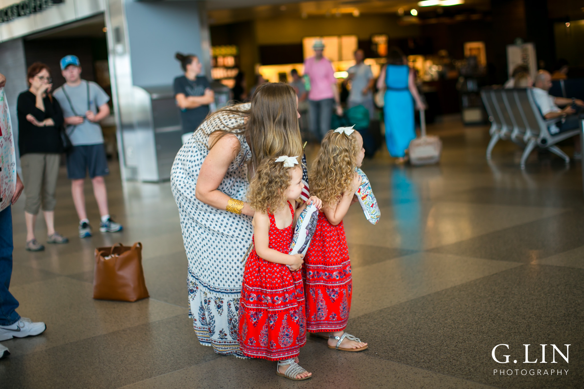 Raleigh Family Photographer | G. Lin Photography | girls and mom waiting for their dad at terminal