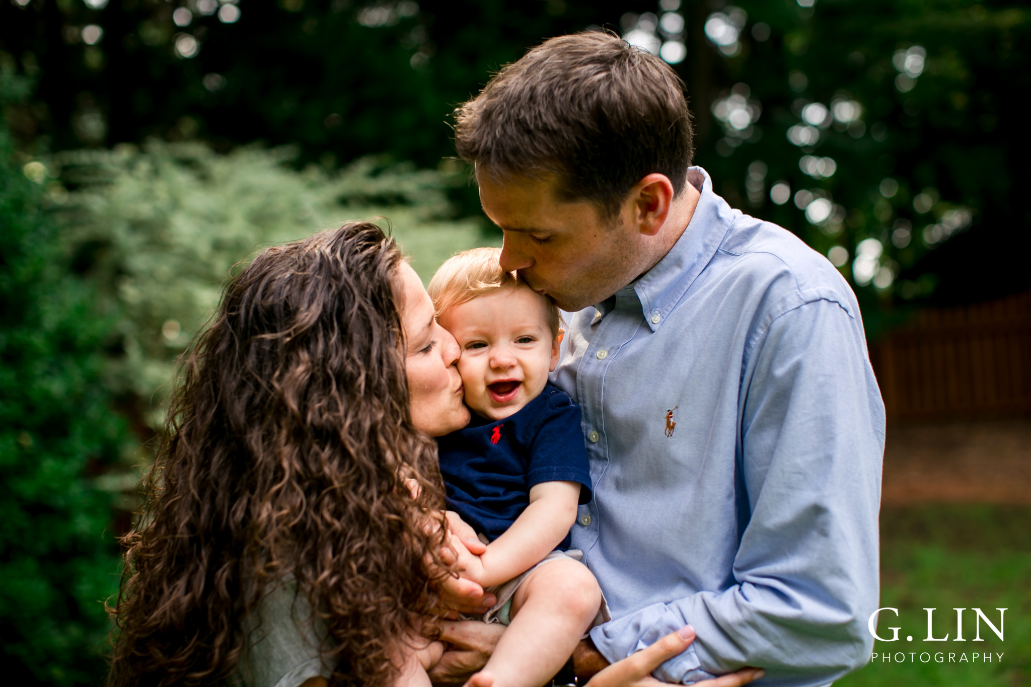 Raleigh Family Photographer | G. Lin Photography | Mom and Dad kissing baby on cheeks